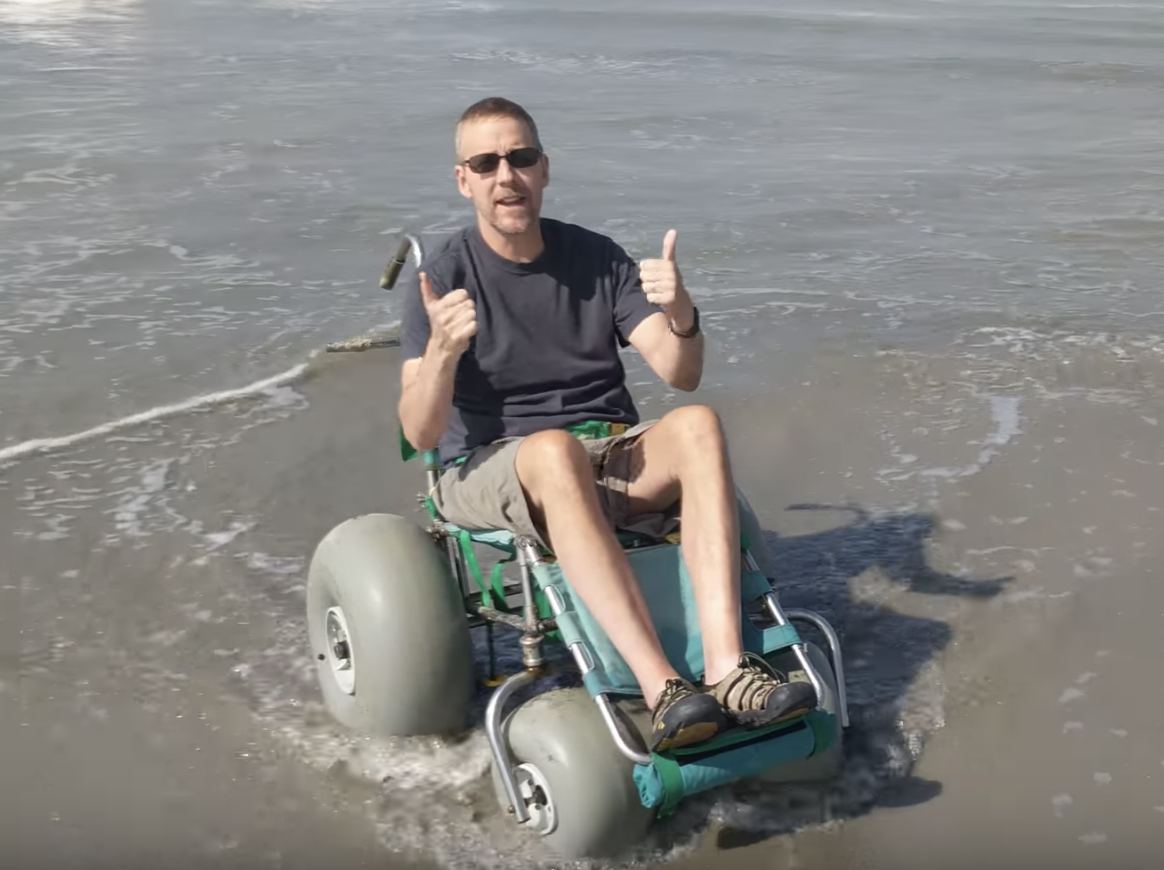 Dave of ActiveMSers in a beach wheelchair