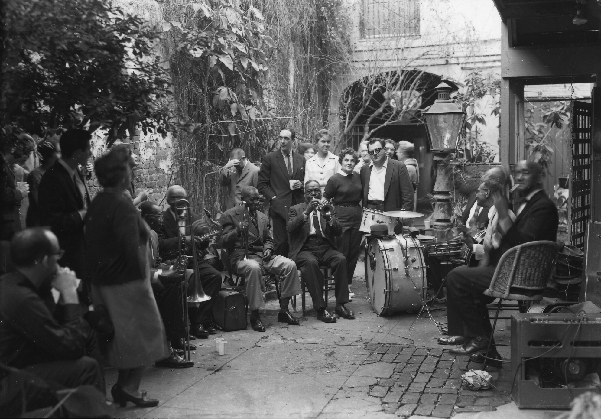Larry Borenstein and friends in the courtyard at 726 St. Peter Street ca. 1958