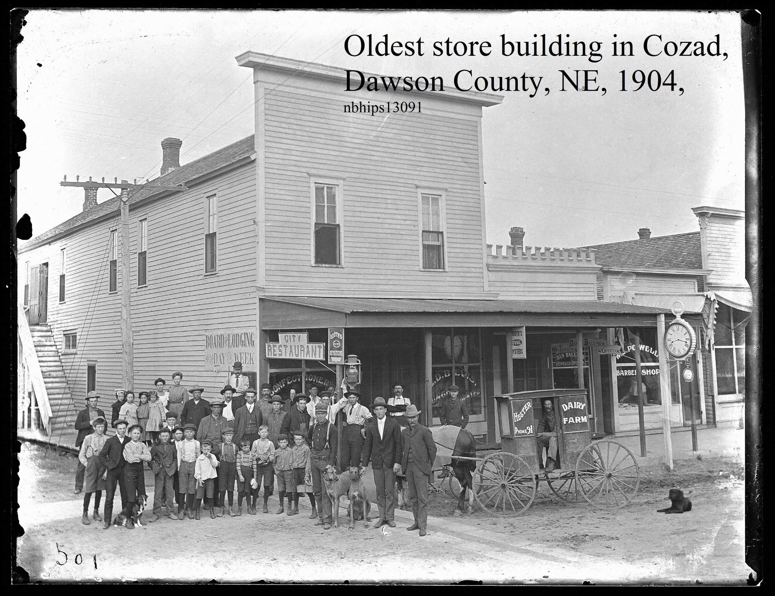 Butcher, Dawson County, Cozad, Oldest store building, 1904, lady in store window.jpg