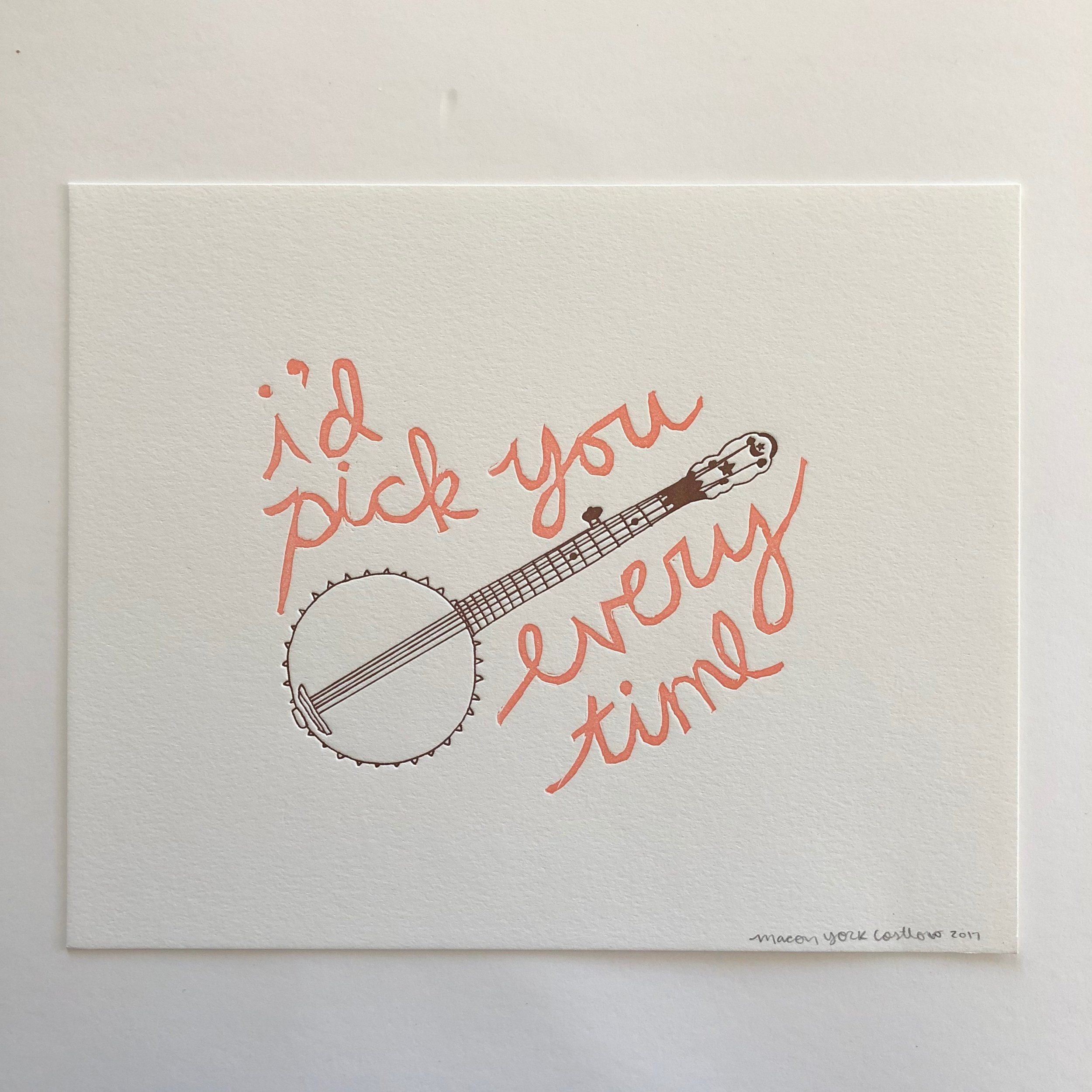 I'D PICK YOU EVERY TIME // BANJO     Who doesn't love a good banjo pun? The text is hand-carved from a linoleum block and the banjo is hand-drawn. Two color print: peach and brown.
