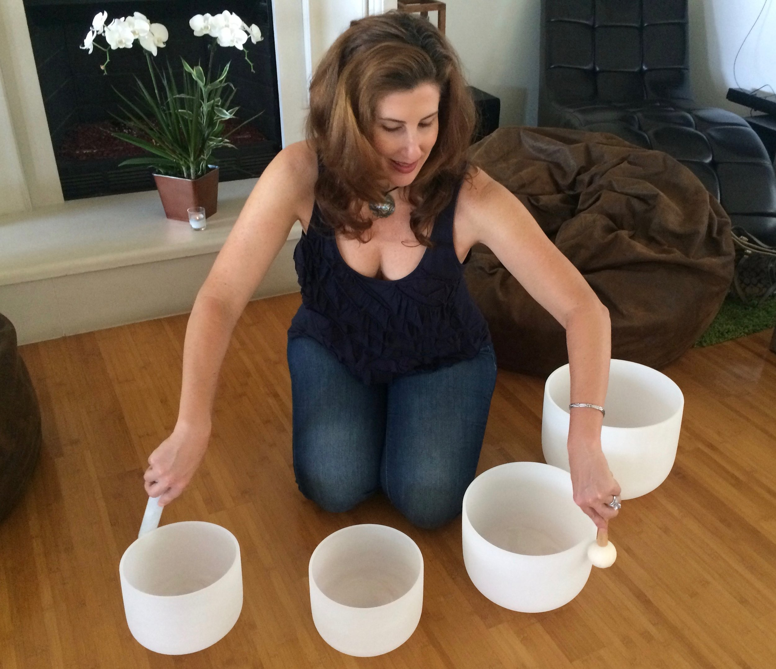 Kristin Palombo plays her Quartz Crystal Singing Bowls during a private in-home Sound Bath