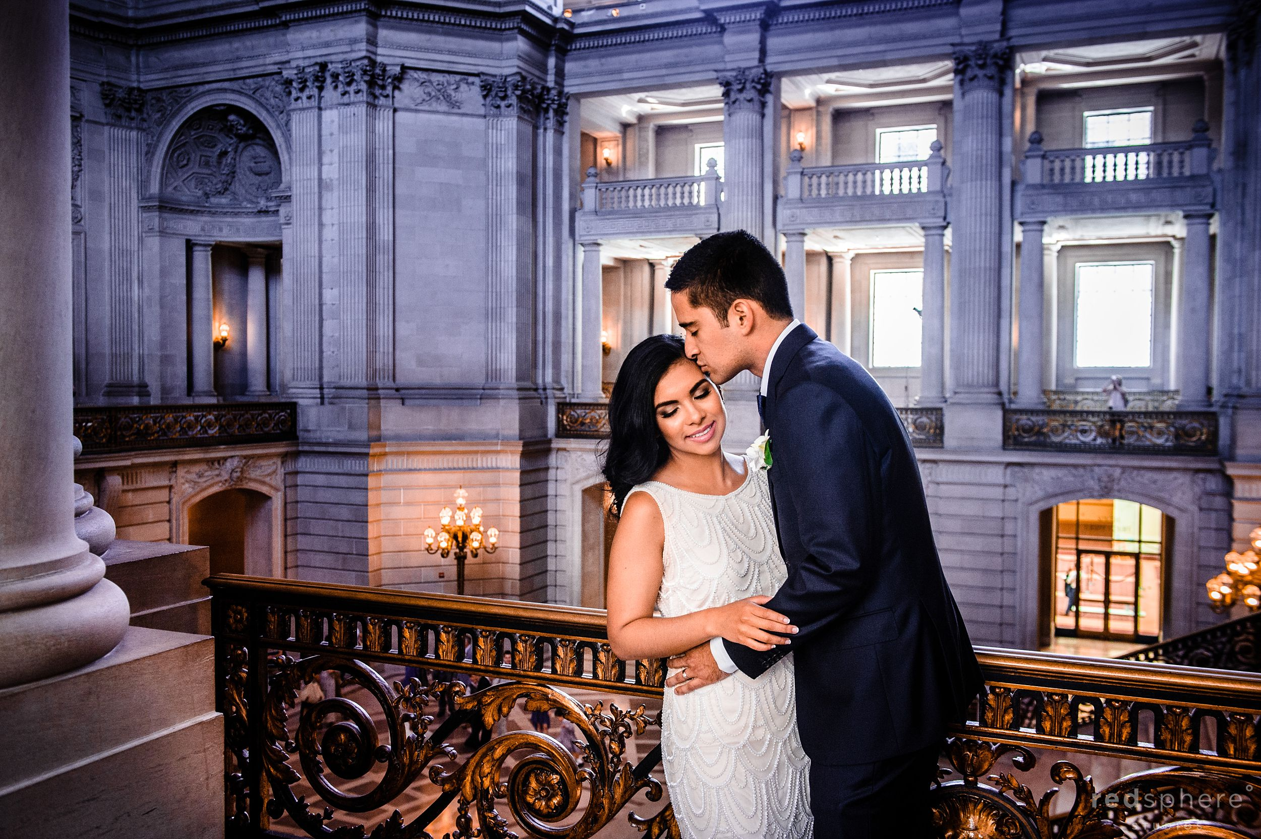Groom Kisses Bride's Forehead Before San Francisco City Hall Wedding Ceremony