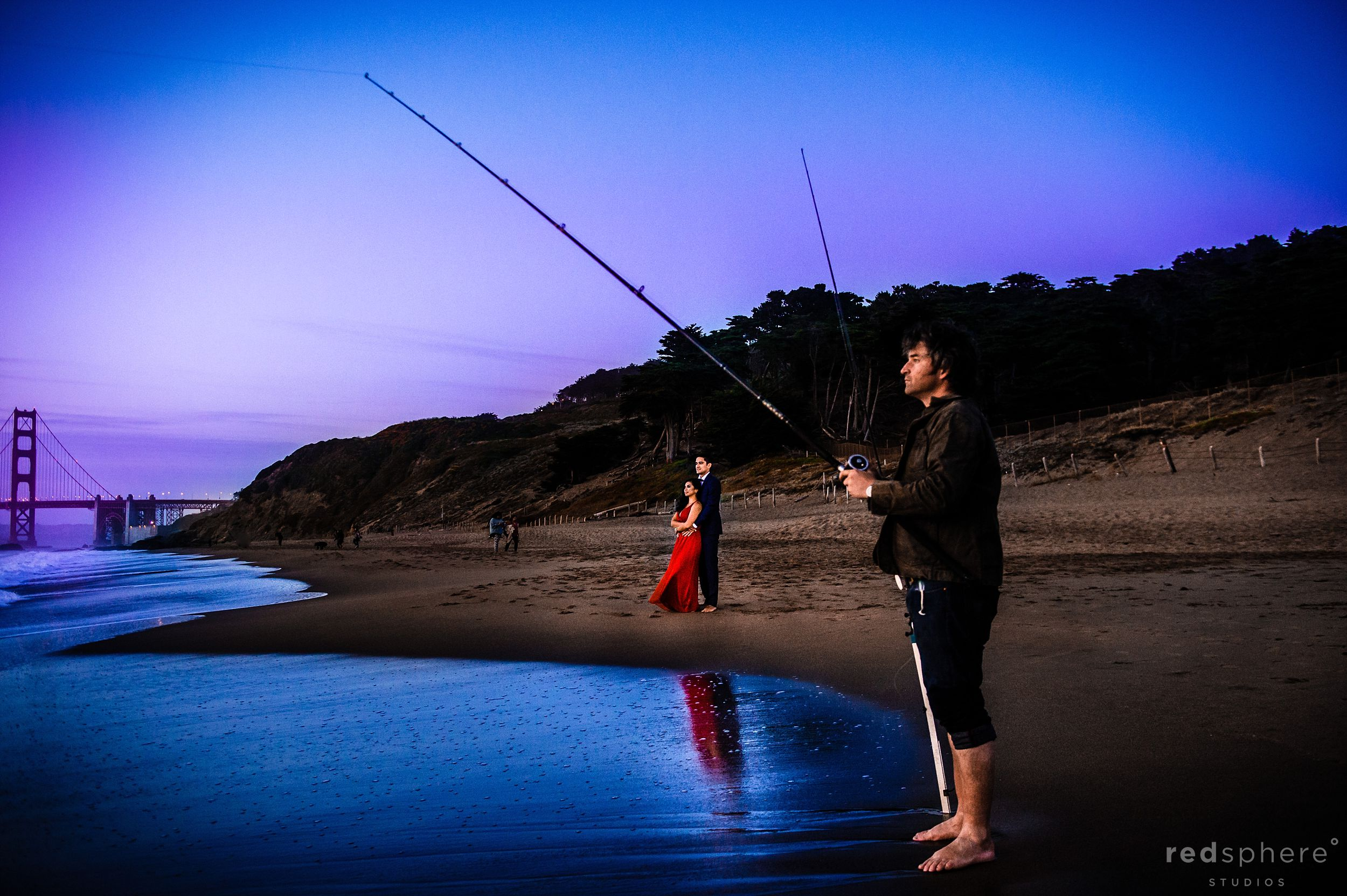 Fisherman and Couple Reflection at San Francisco's Baker Beach Engagement