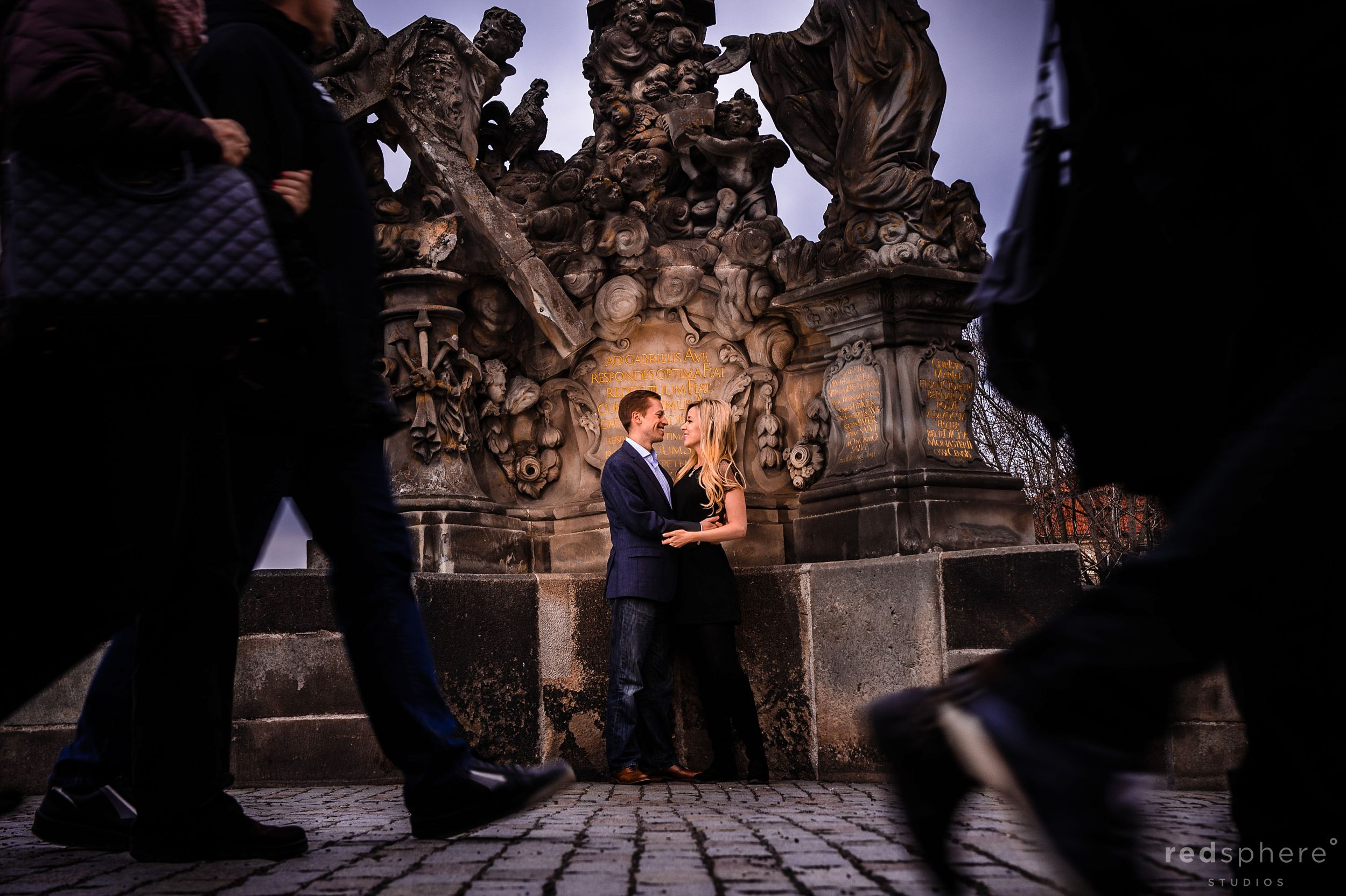 Couple Gazes Into Each Other's Eyes During Engagement at Charles Bridge, Prague