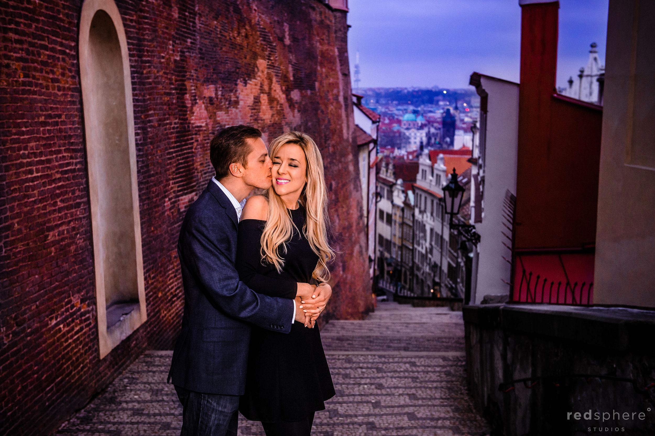 Peter Gives Vanessa A Kiss at Old Town Prague Engagement