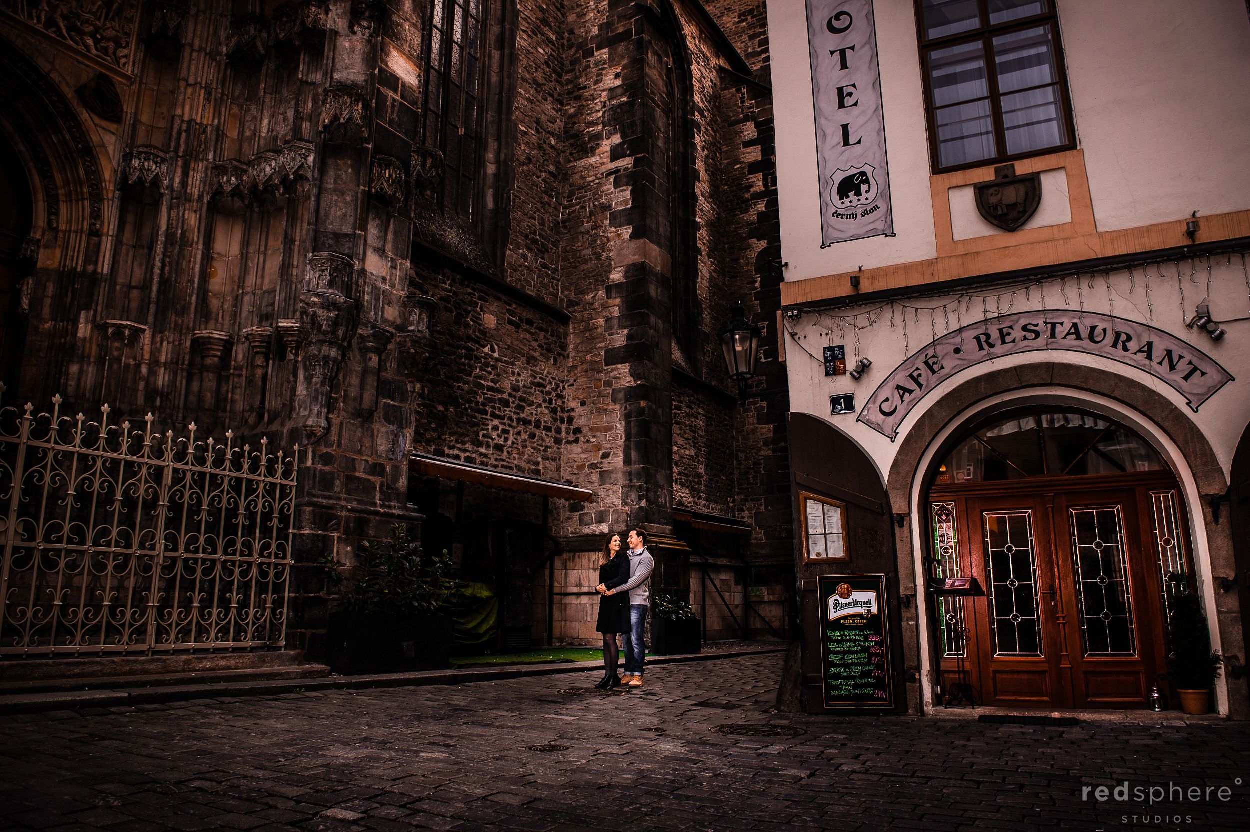 Couple Holding Each Other at Old Town Prague Engagement