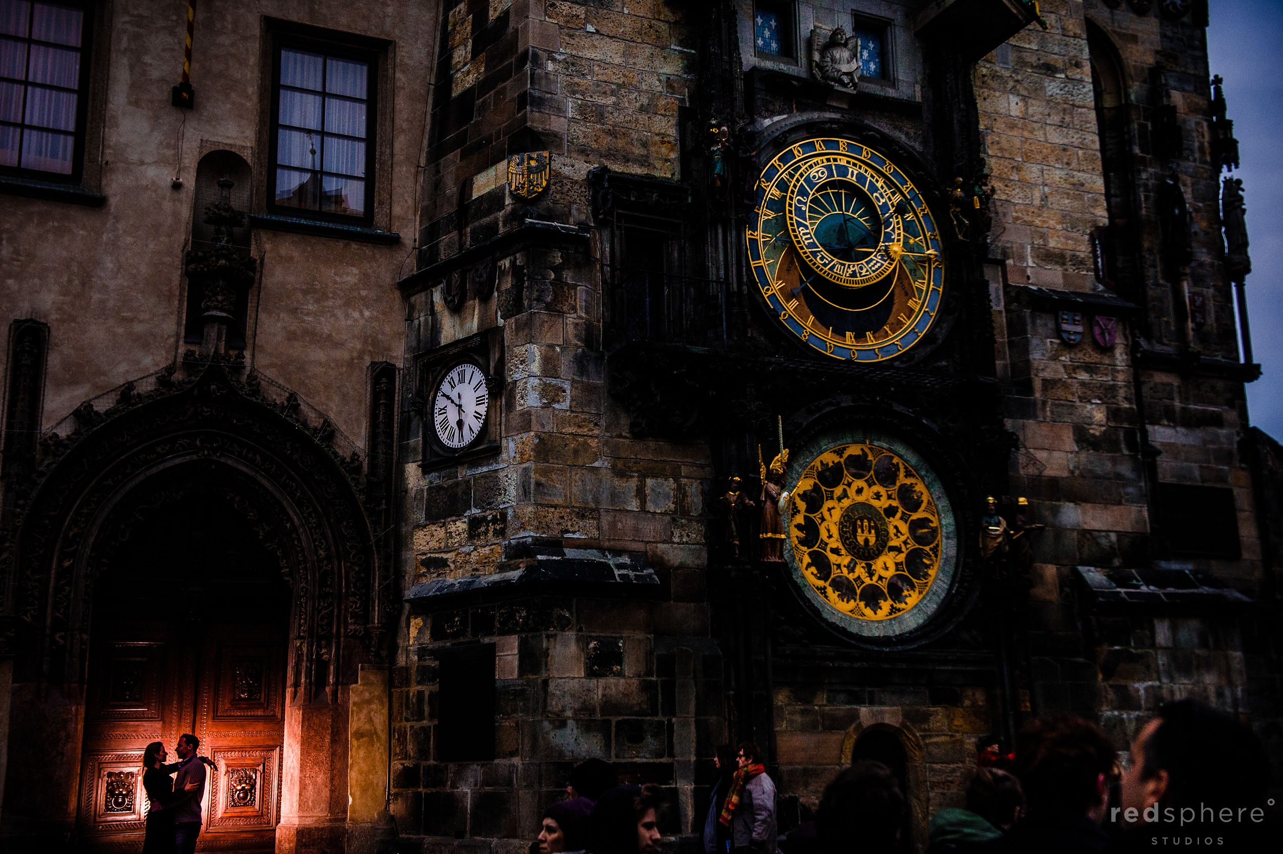 Couple in Distance at Astronomical Clock on the Old Town Square Prague