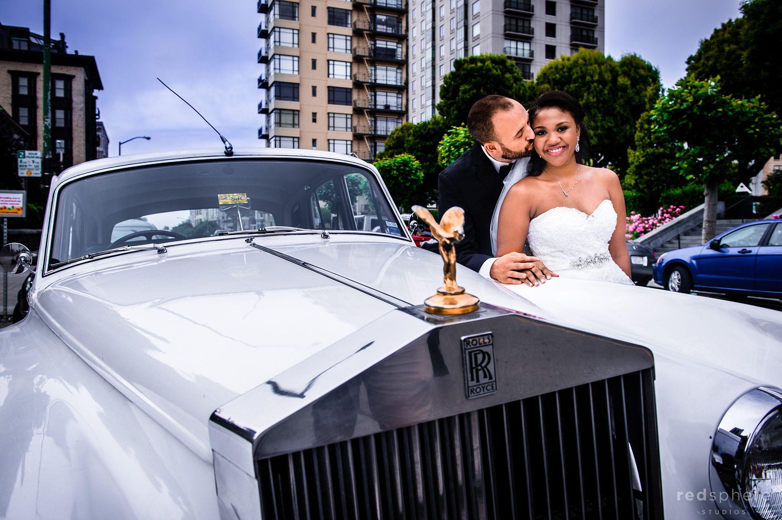 Groom Kisses Bride Next to White Vintage Car, Nob Hill San Francisco