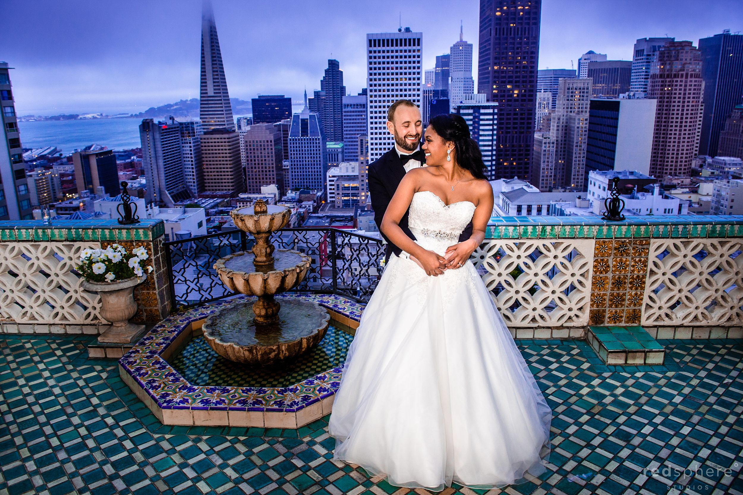Bride and Groom With San Francisco Skyline Background, Fairmont Hotel Penthouse Suite