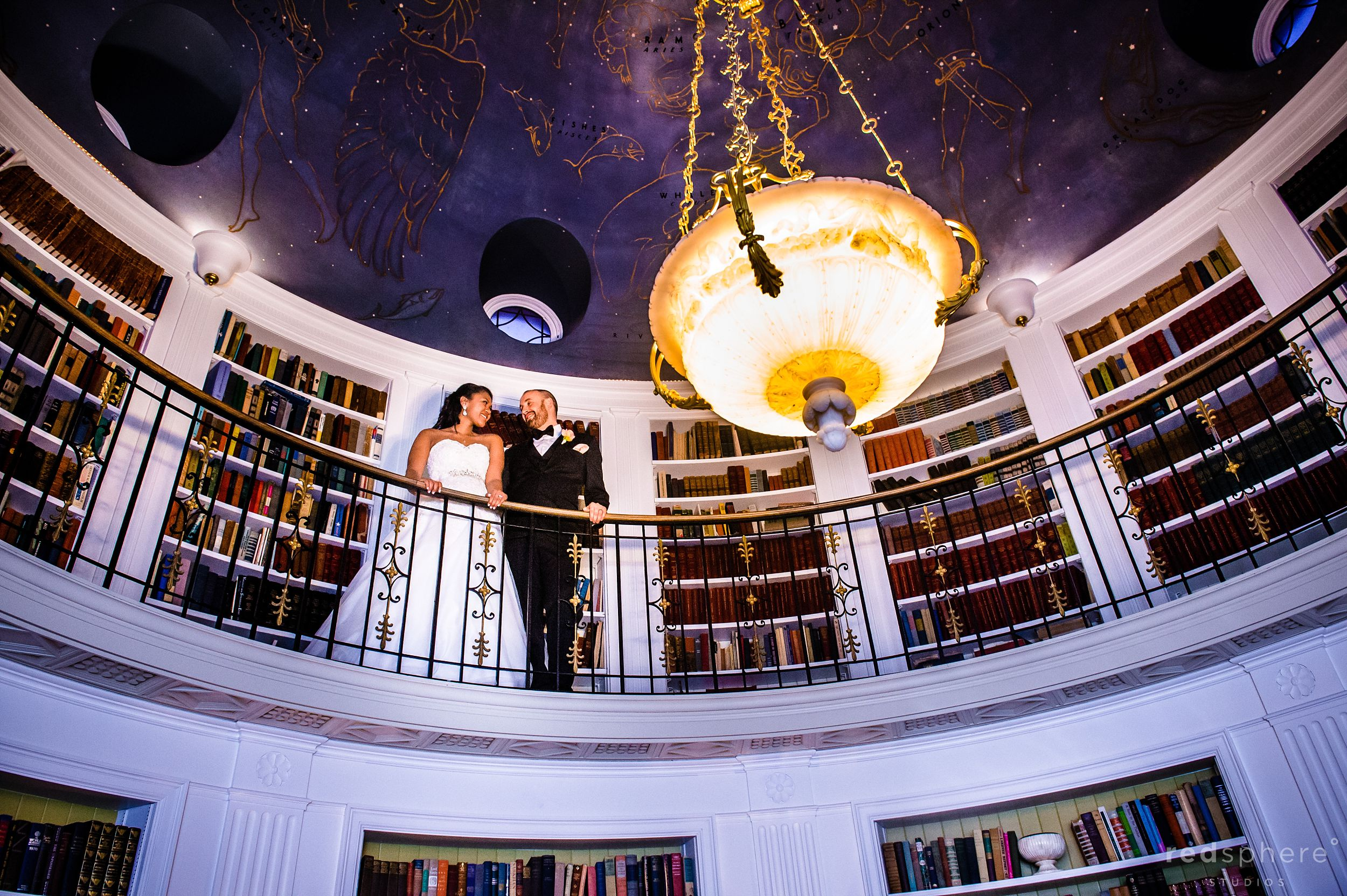 Bride and Groom on Top Level of Bookcase at Fairmont Hotel Penthouse Suite