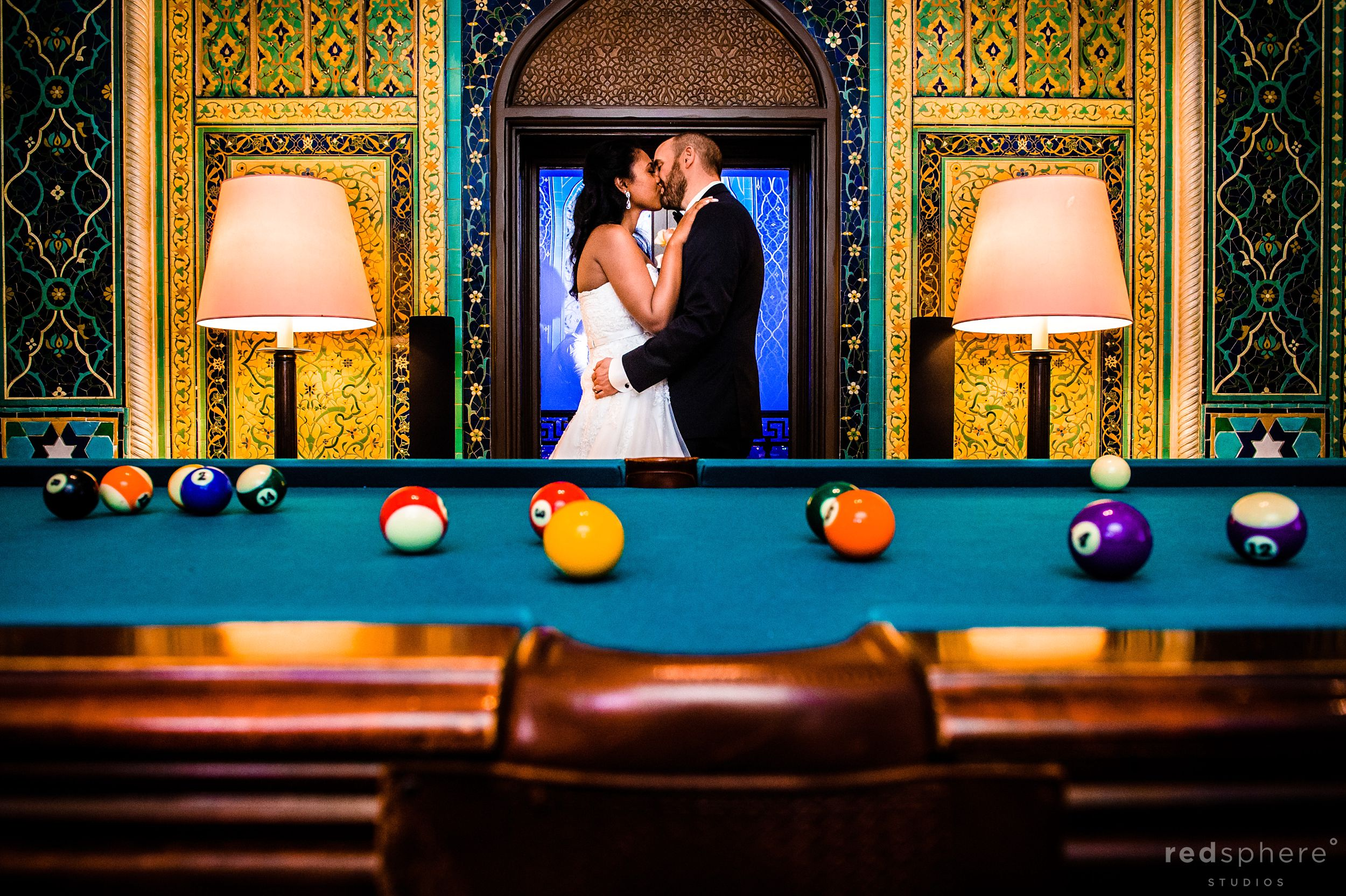 Bride and Groom Share Kiss at Fairmont Hotel, Unique Composition With Pool Table