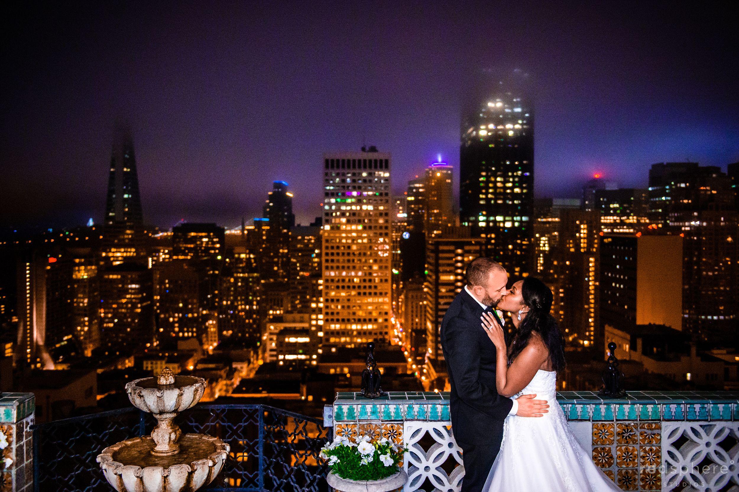 Wedding Kiss Against the Dark San Francisco Skyline, Fairmont Hotel Penthouse Suite
