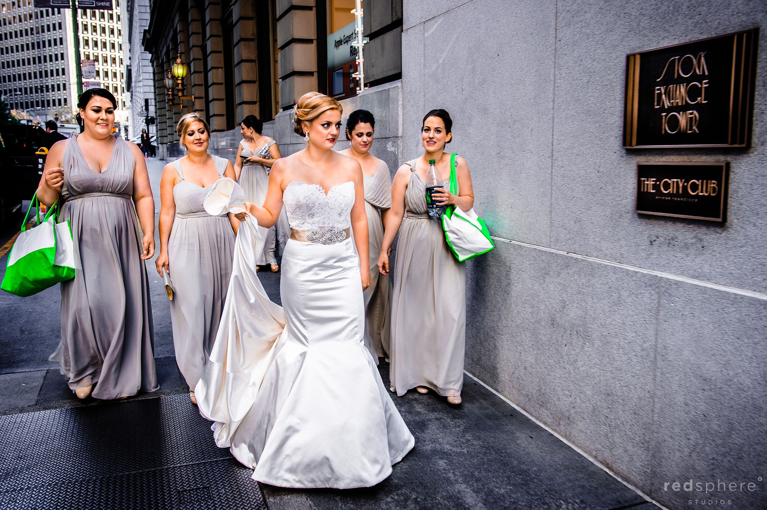 Bride Walking Towards City Club Wedding Followed by Bridesmaids'