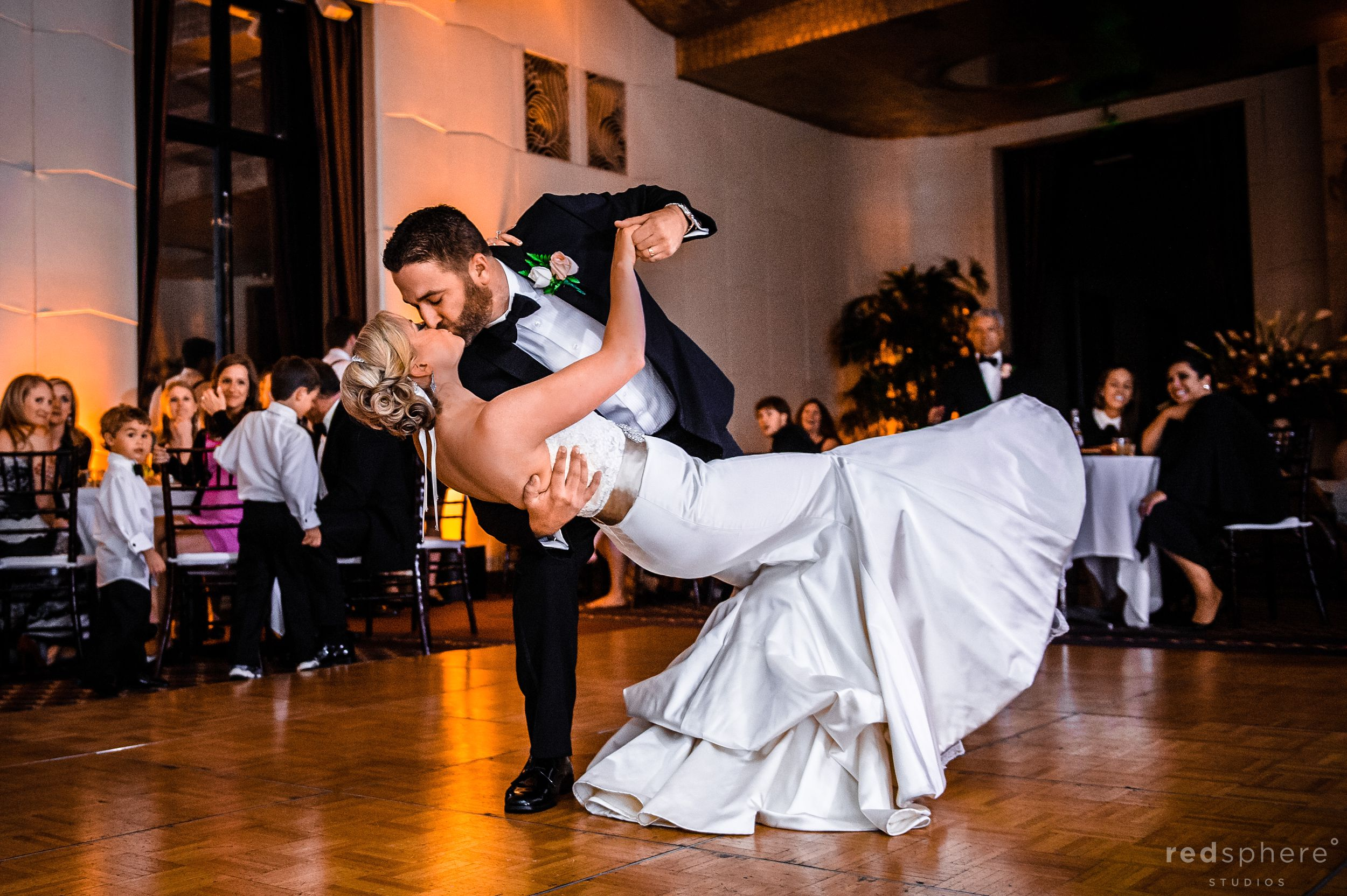 Bride and Groom Share a Kiss While Dancing After Wedding Ceremony