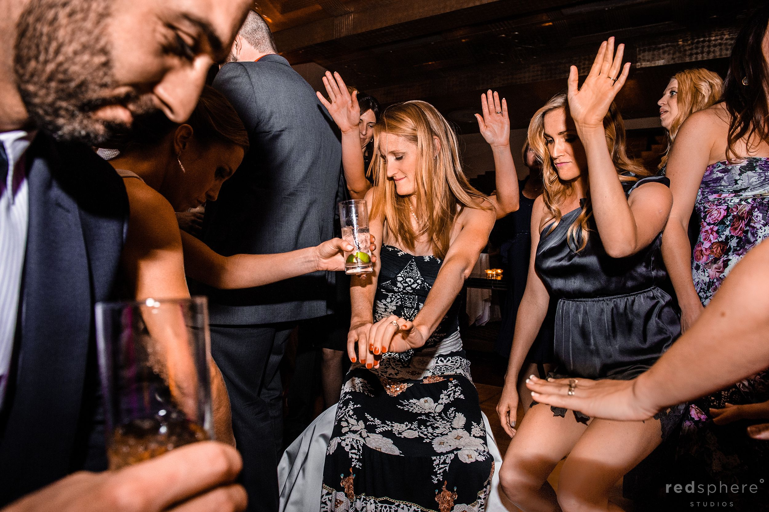 Guests Putting Their Hands Up and Dancing at City Club Wedding After Party