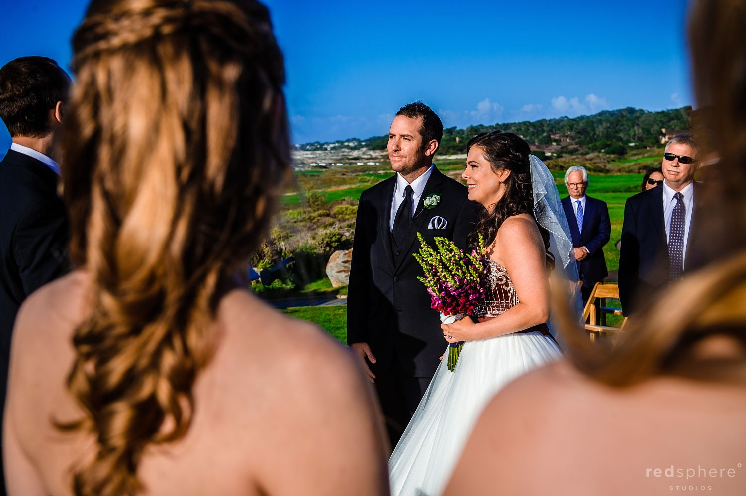 Guest View of Bride and Groom Looking Towards Their Officiant