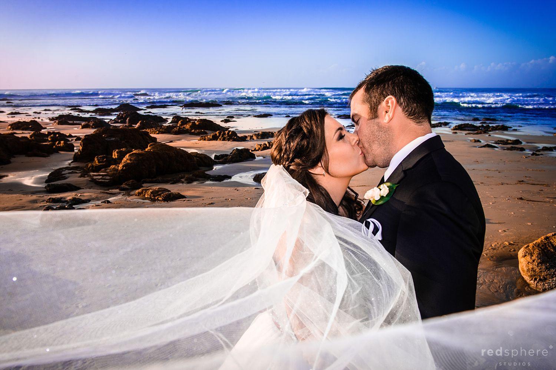 Bride and Groom Kiss at Pebble Beach, California