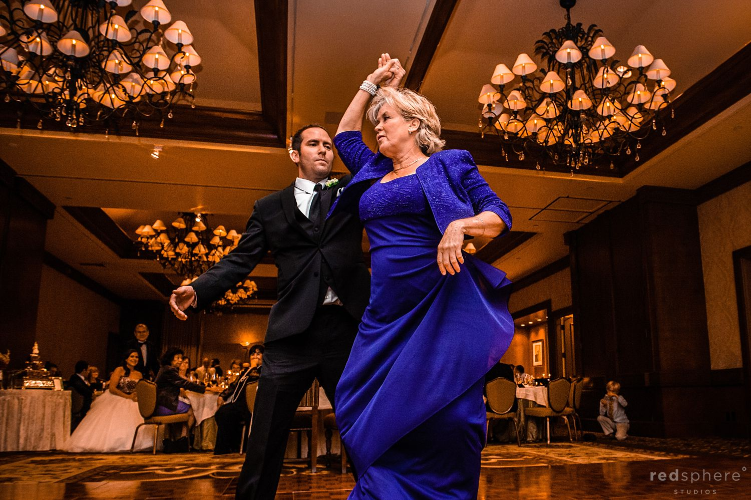 Family Members Dancing at Pebble Beach After Party at The Inn at Spanish Bay