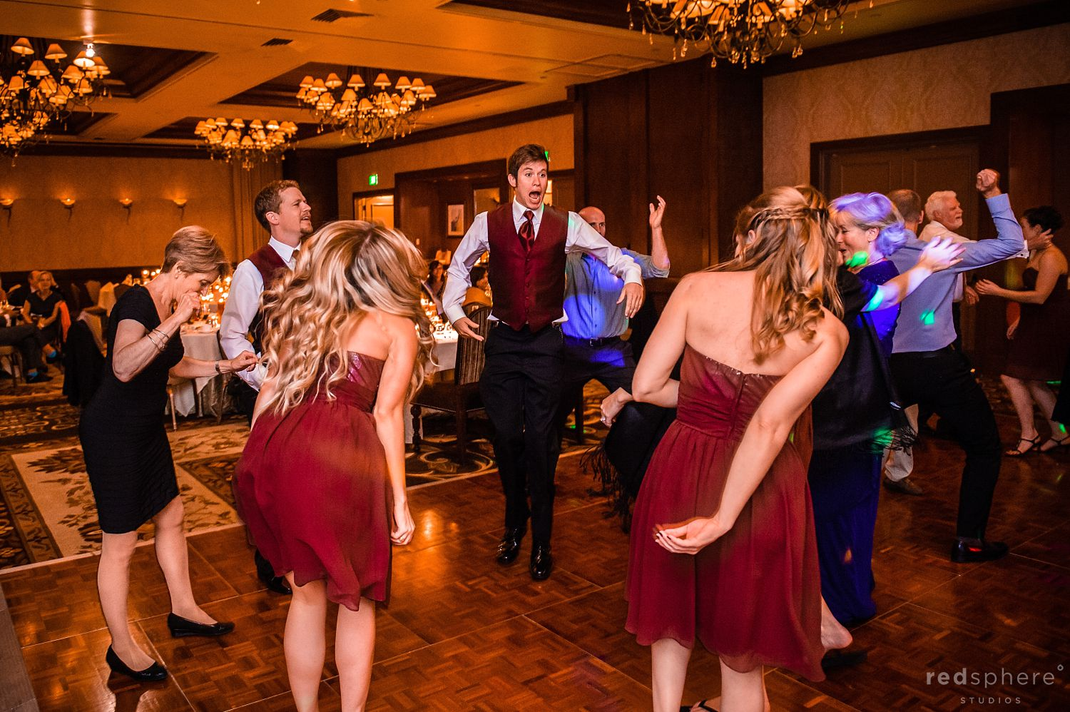 Bridesmaids' and Guests Dance on Dance Floor at The Inn at Spanish Bay