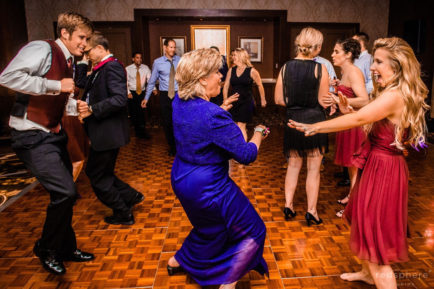 Family Members Dance Together at The Inn at Spanish Bay Wedding Reception