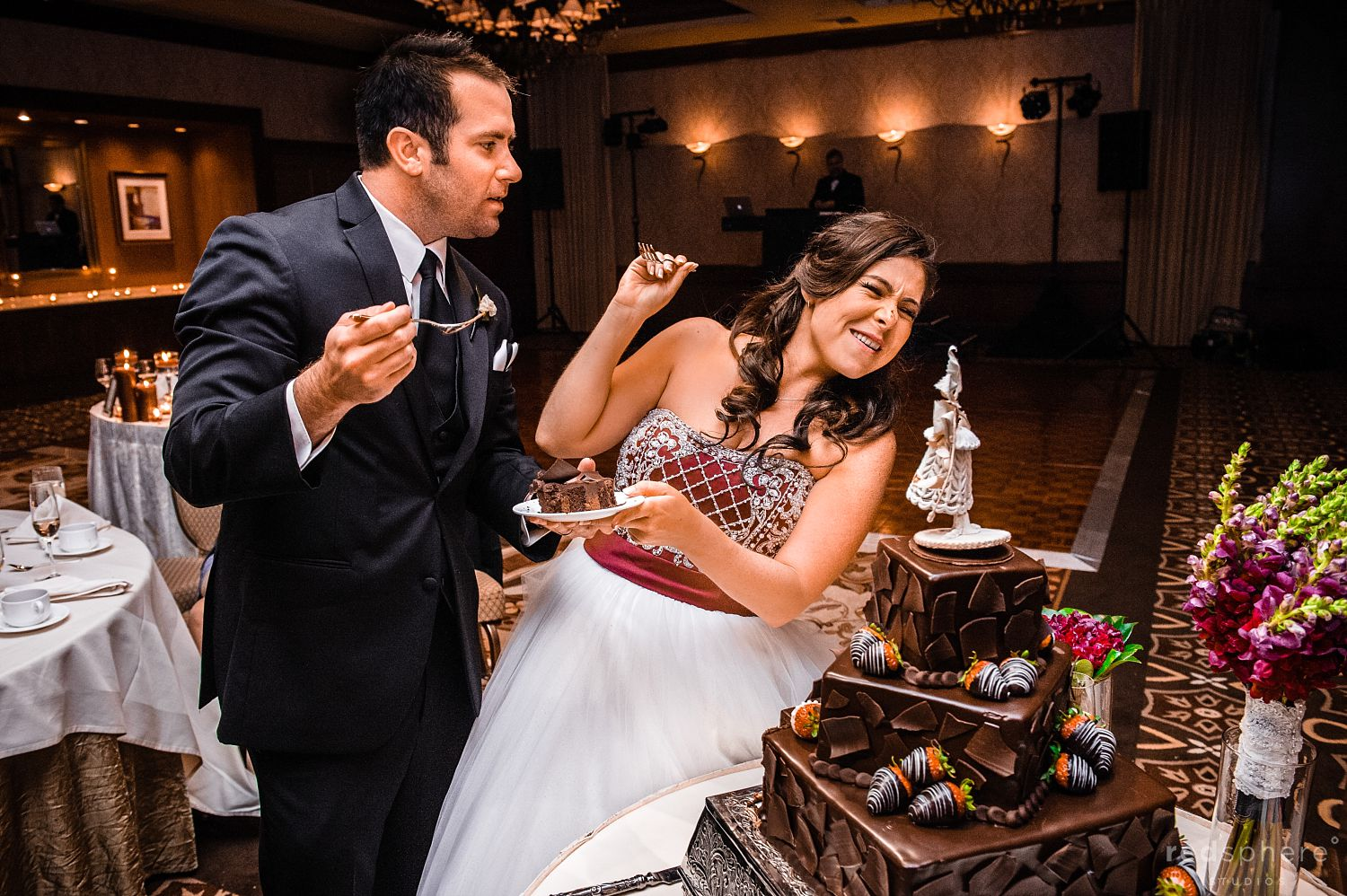 Bride and Groom Share Cake at The Inn at Spanish Bay After Party