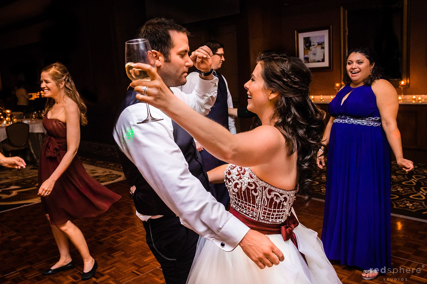 Bride and Groom Share a Drink and a Dance at The Inn at Spanish Bay Wedding