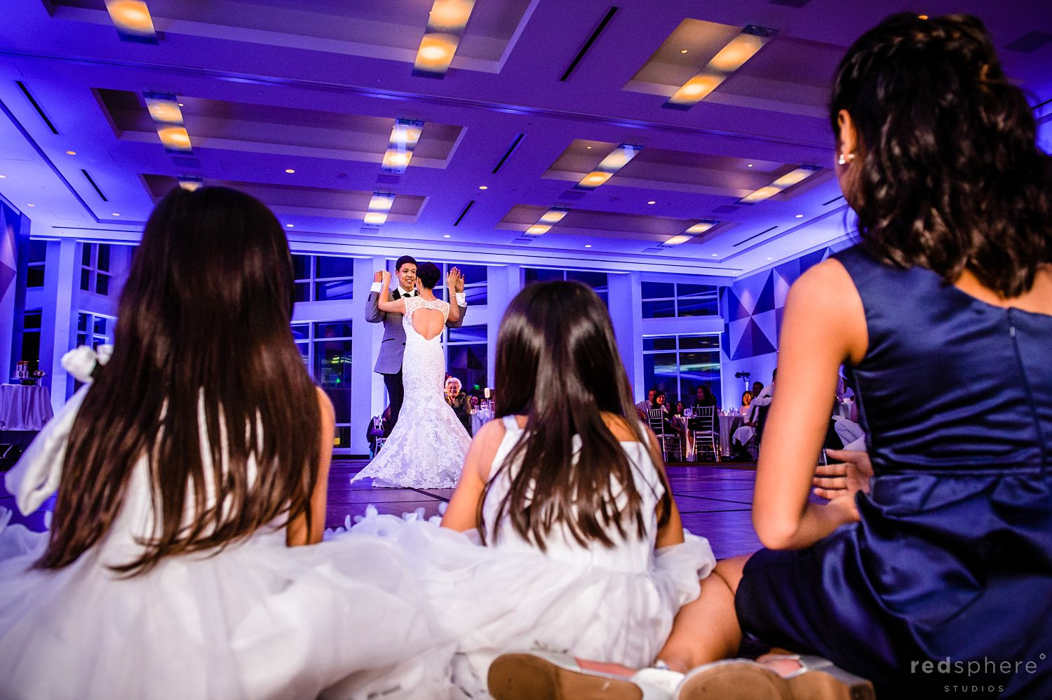 Bride and Groom Dance as Family and Friends Watch
