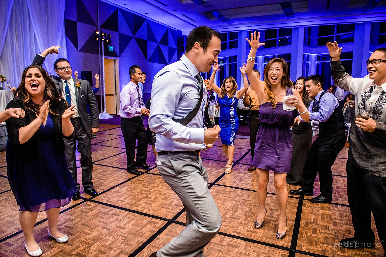 Guests Dance and Cheer Each Other on at Intercontinental Hotel Wedding Reception