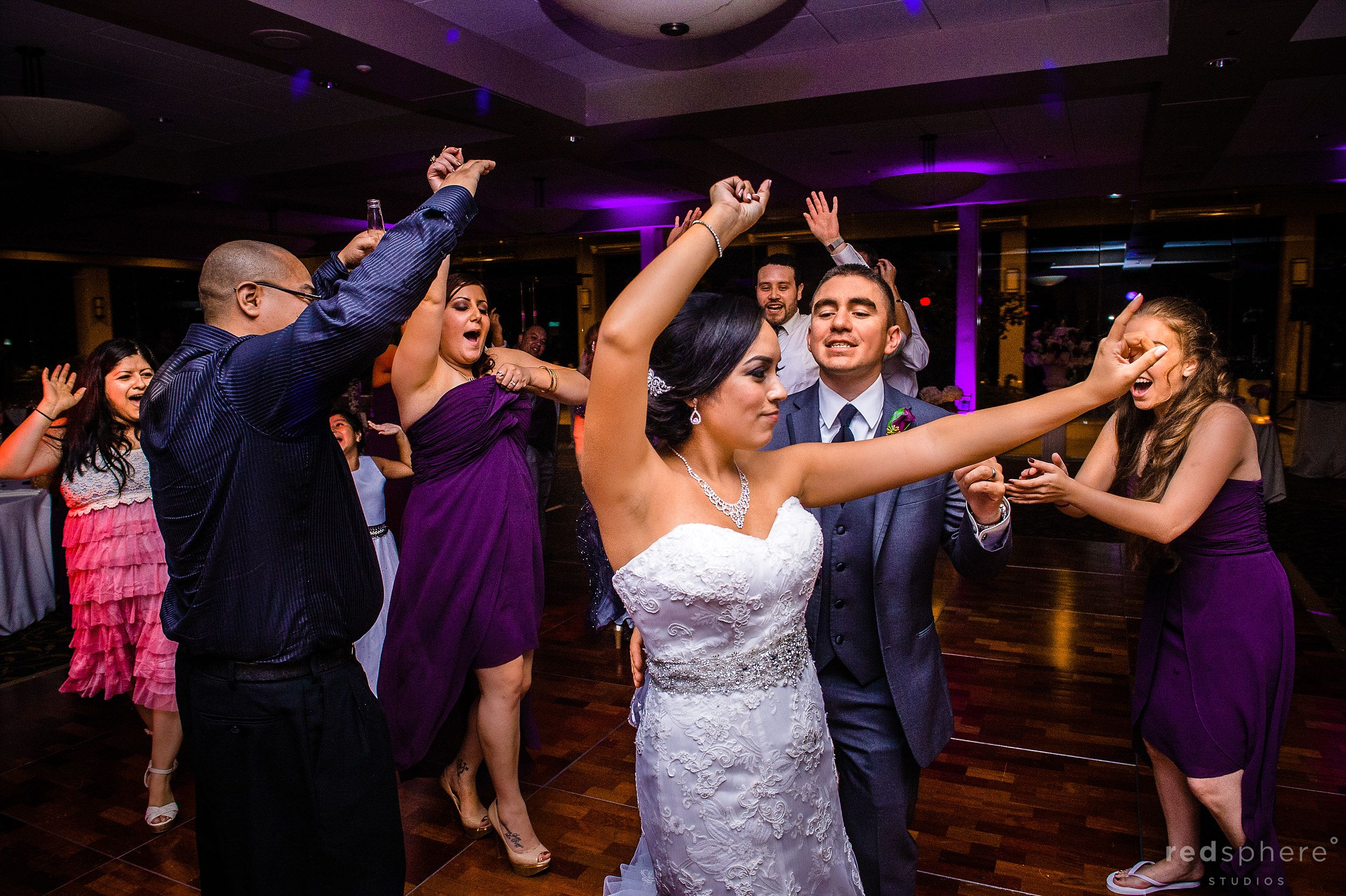 Bride and Groom Share the Dance Floor With Guest at Palo Alto Hills Golf Club