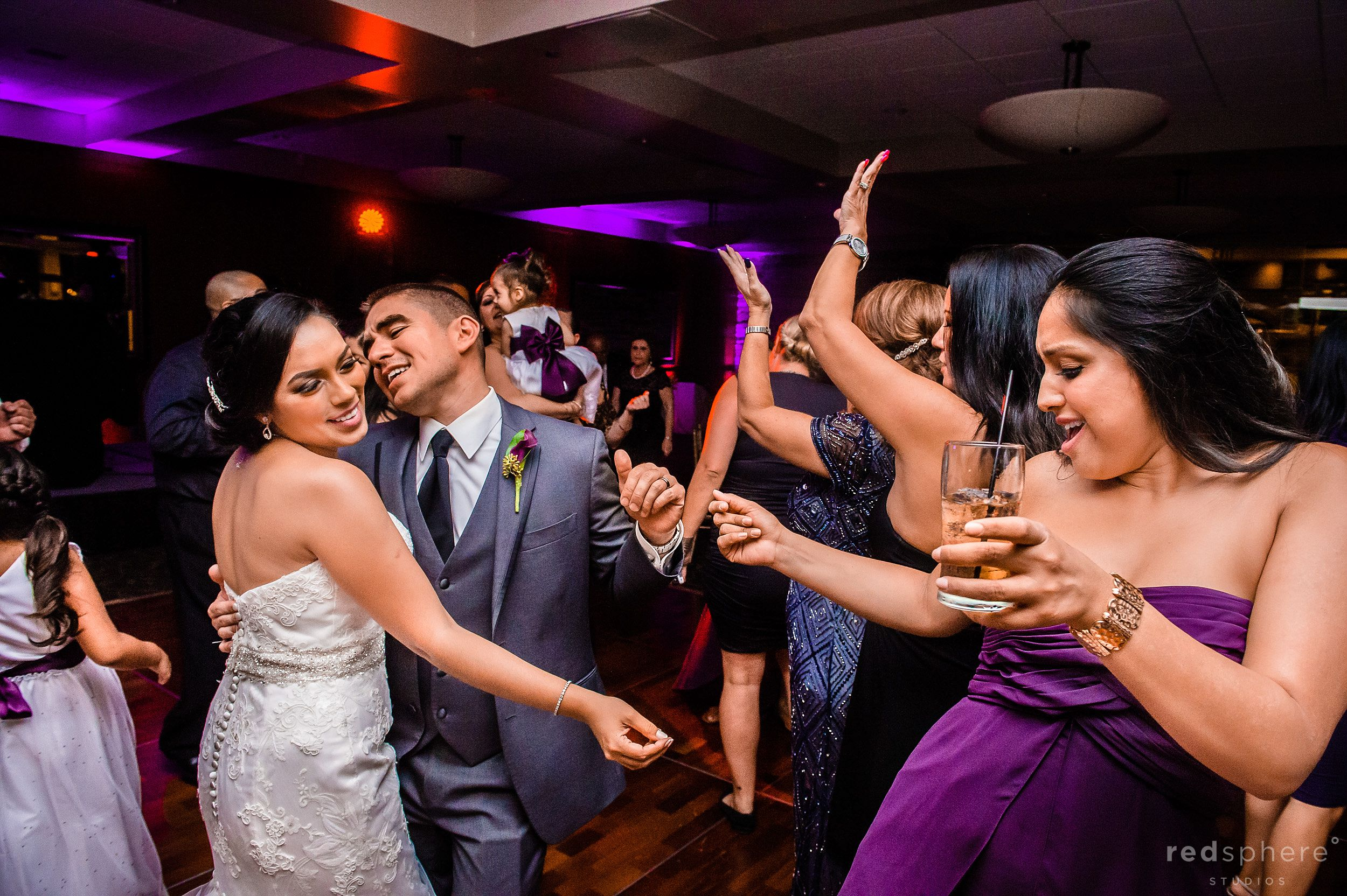 Bride and Groom Dancing With Bridesmaid
