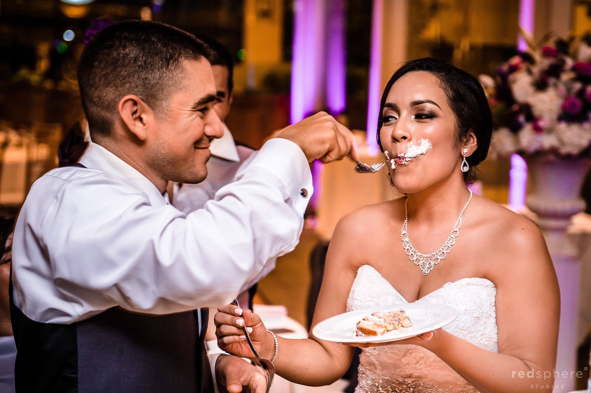 Groom Feeding the Bride Some Cake at Palo Alto Hills Golf Club Reception