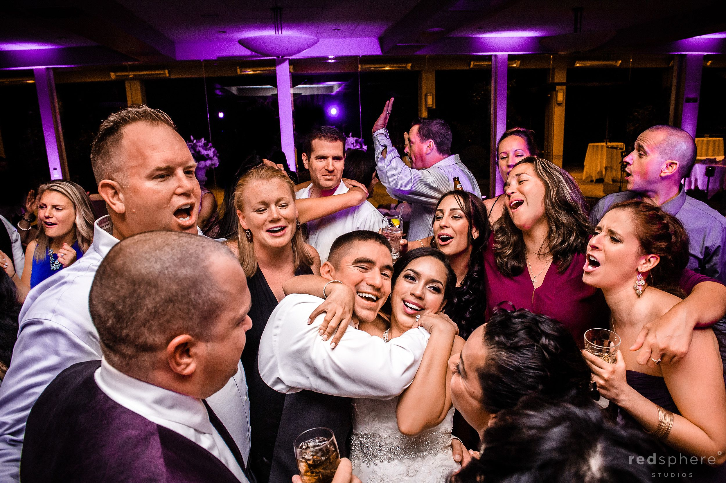 Bride and Groom Surrounded by Family and Friends as the Night Ends at Palo Alto Hills Golf Club