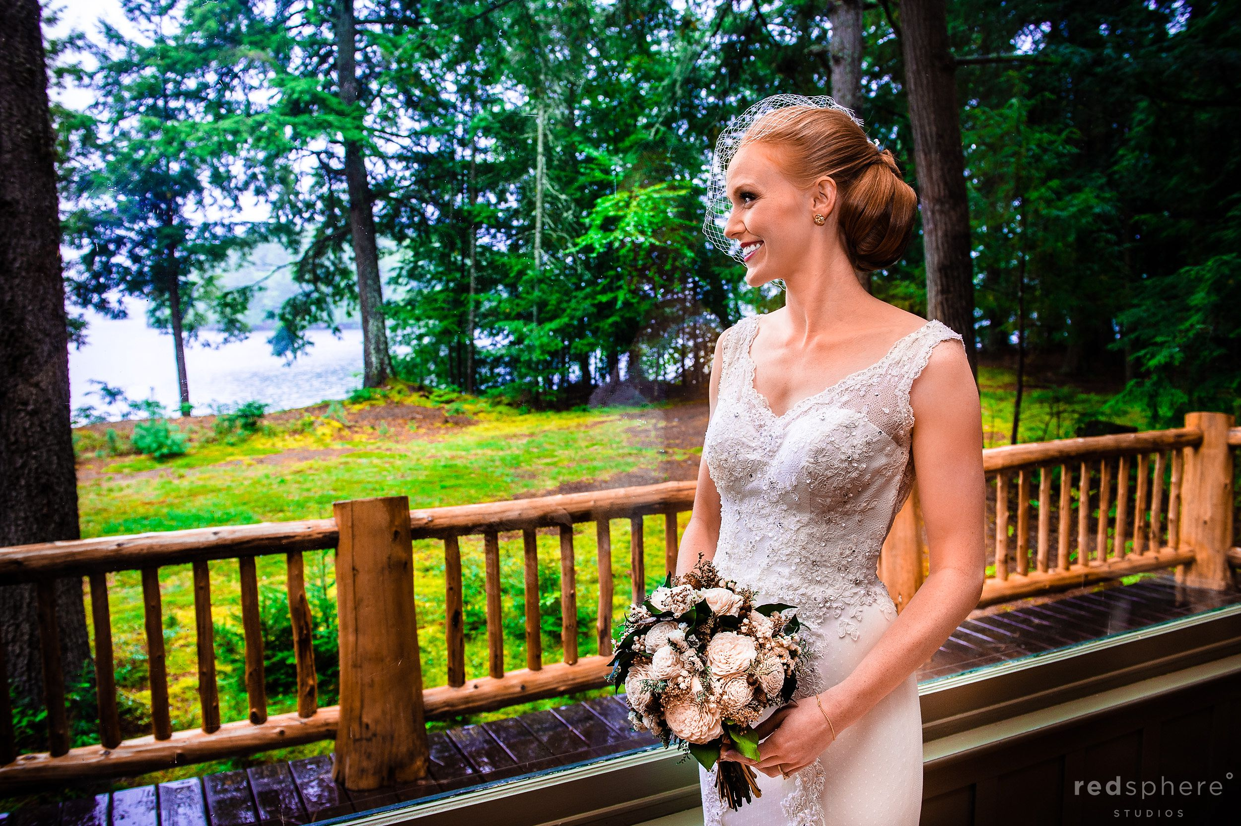 Bride with Flowers on the Patio of Chapel Islands Cabin Balcony
