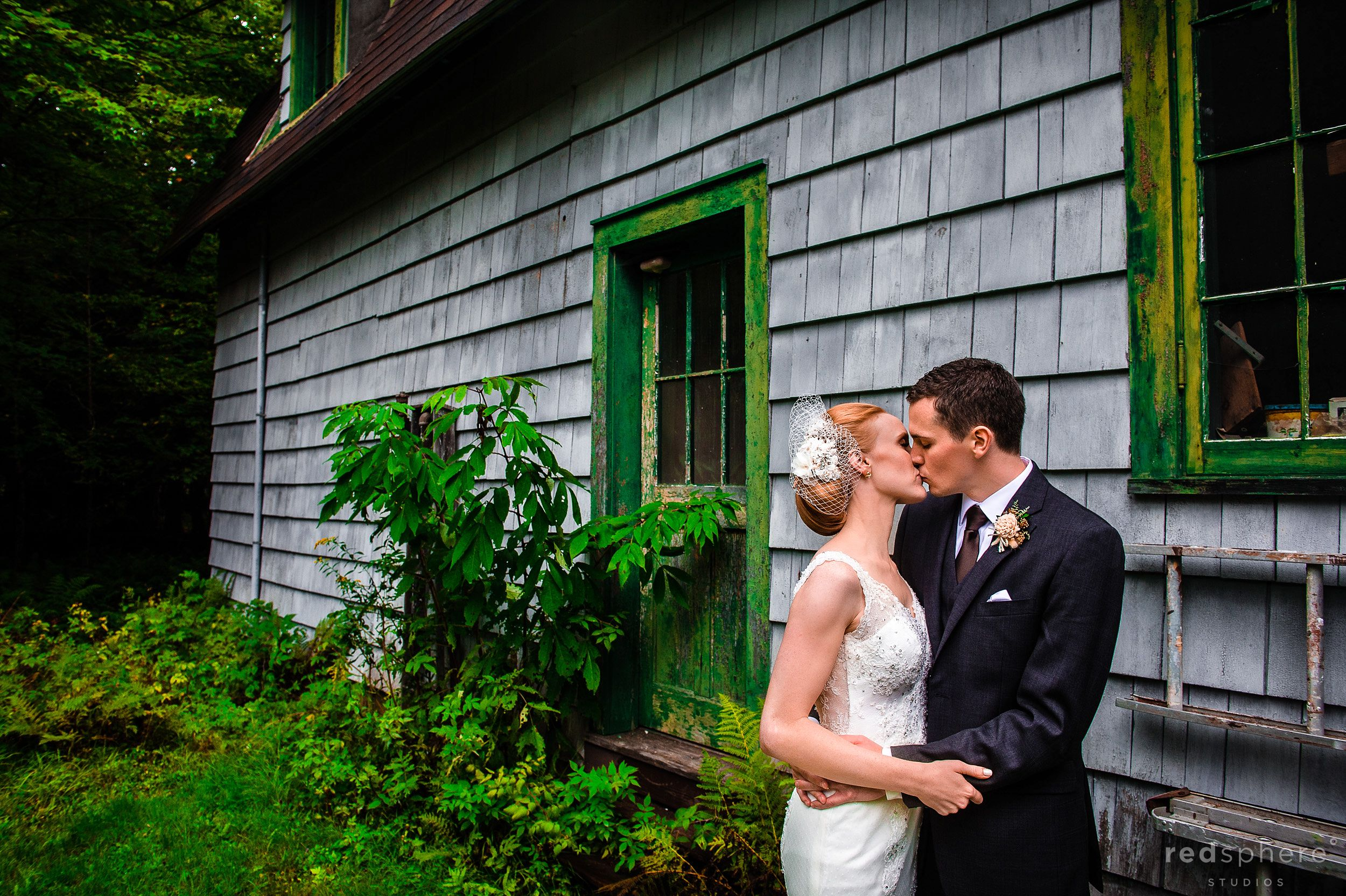 Bride and Groom Kiss Surrounded by Nature at Chapel Island, NY