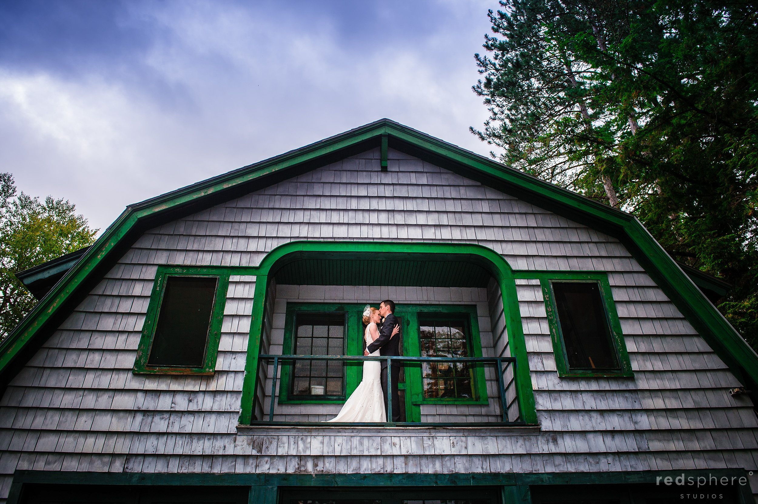 Married Couple Embrace on Chapel Island's Cabin Balcony