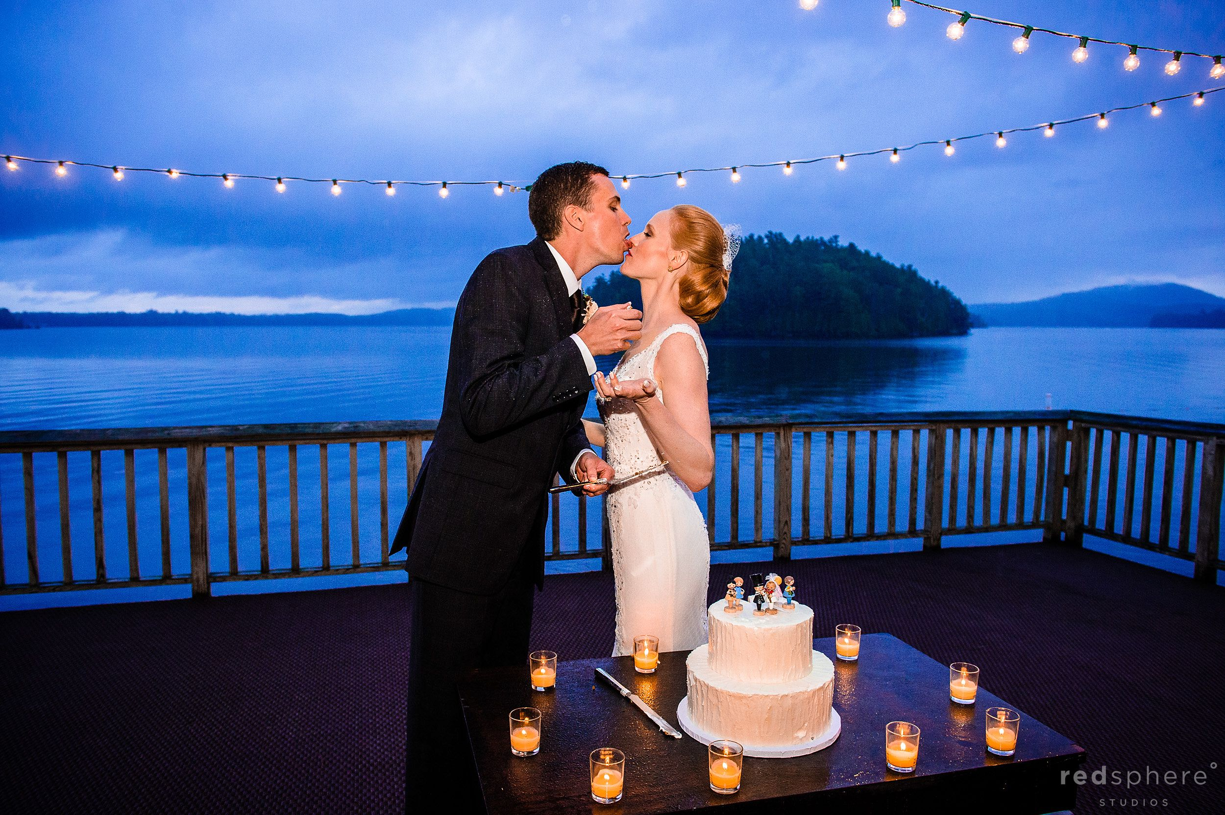 Groom Licking Cake off of Bride Next to Saranac Lake NY