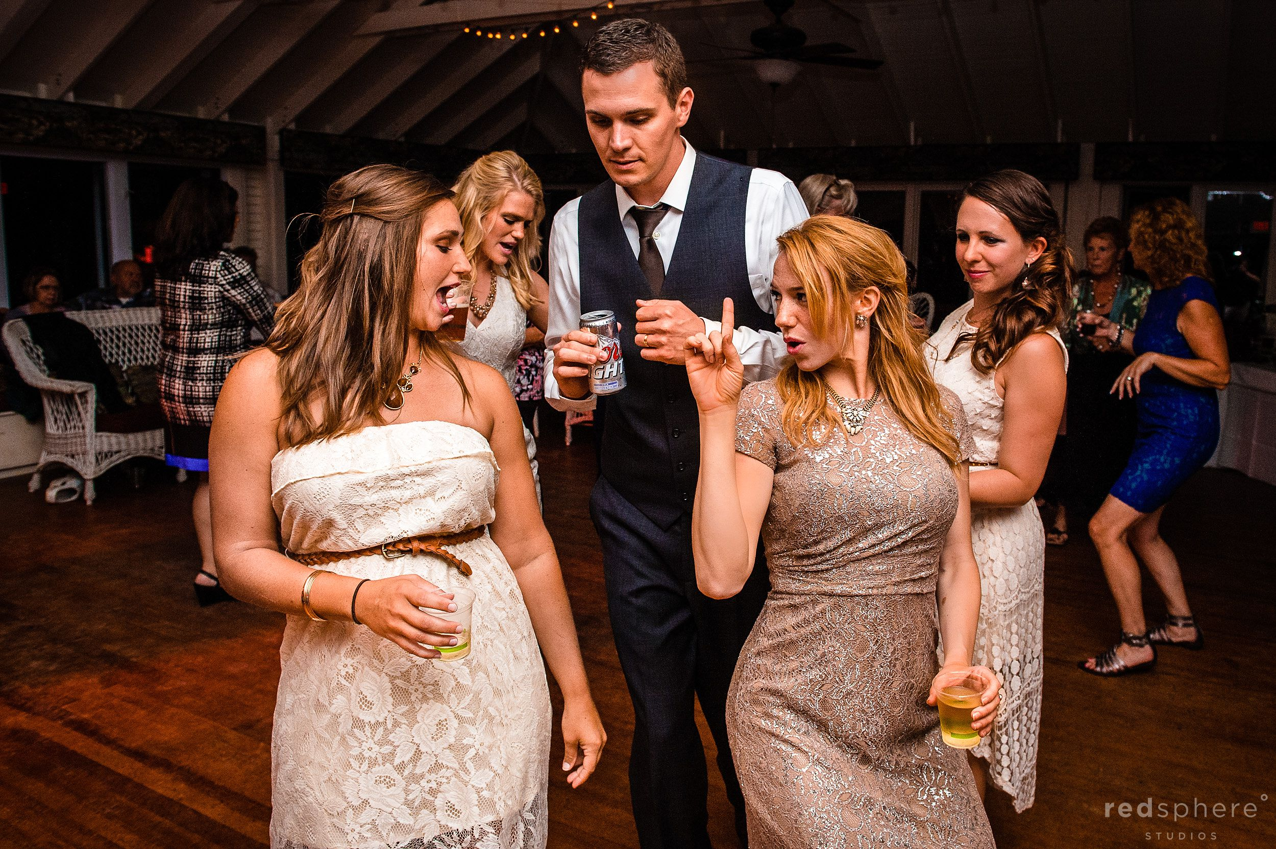 Bride, Maid of Honor, and Groom Dancing