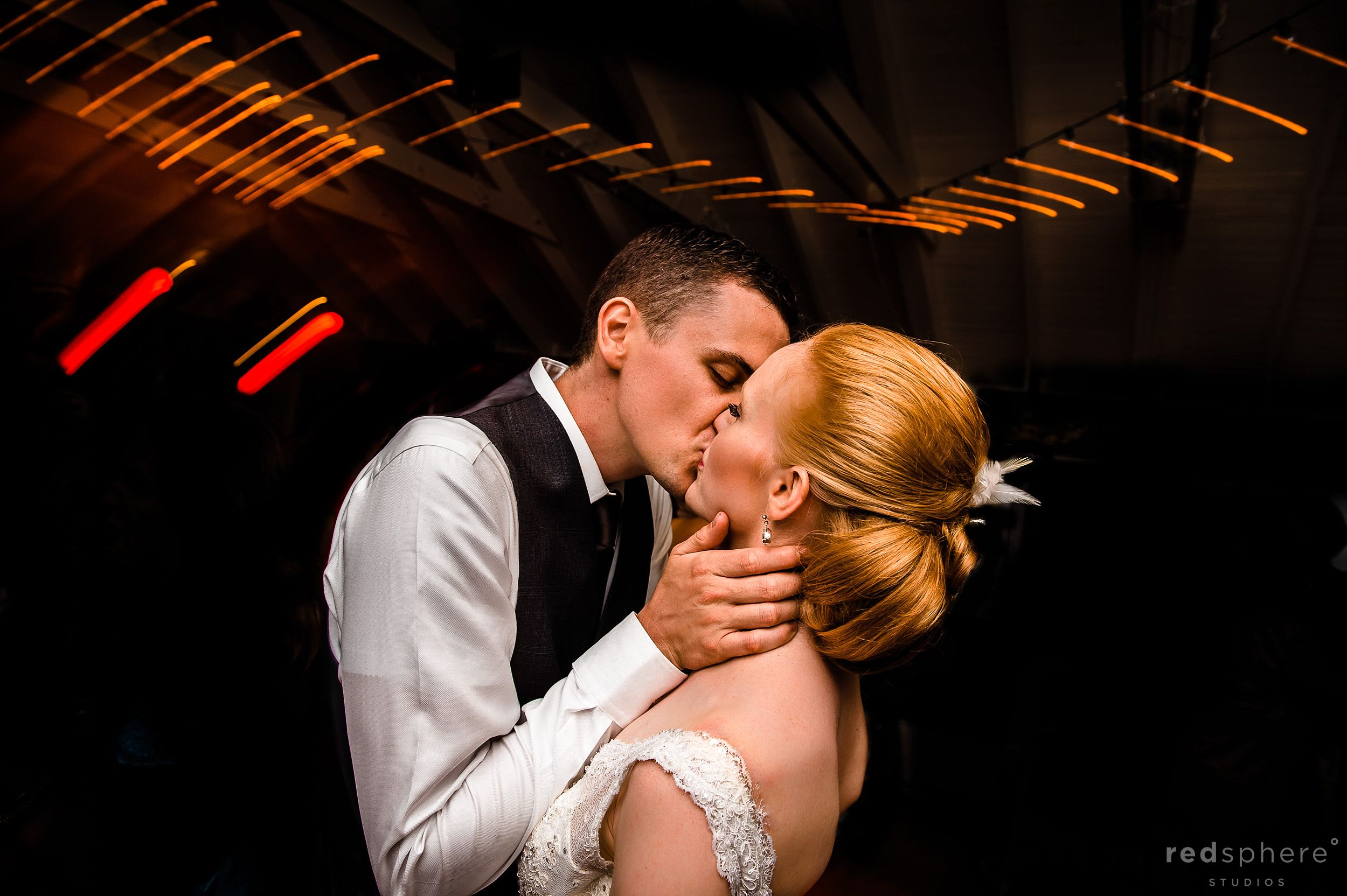 Bride and Groom Kiss While Dancing at Chapel Island Wedding Reception