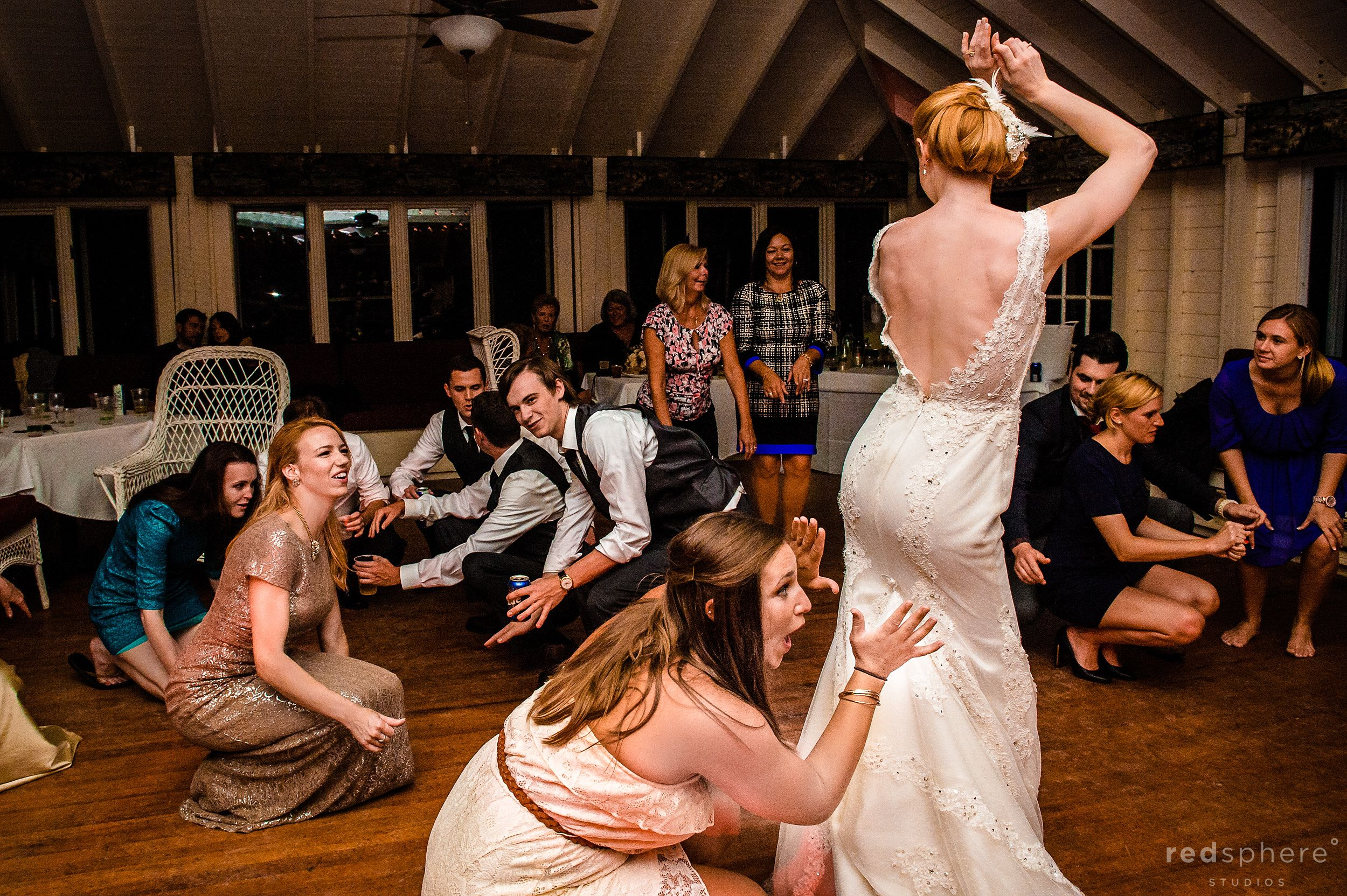 Guests Hail the Bride at Chapel Island Wedding After Party