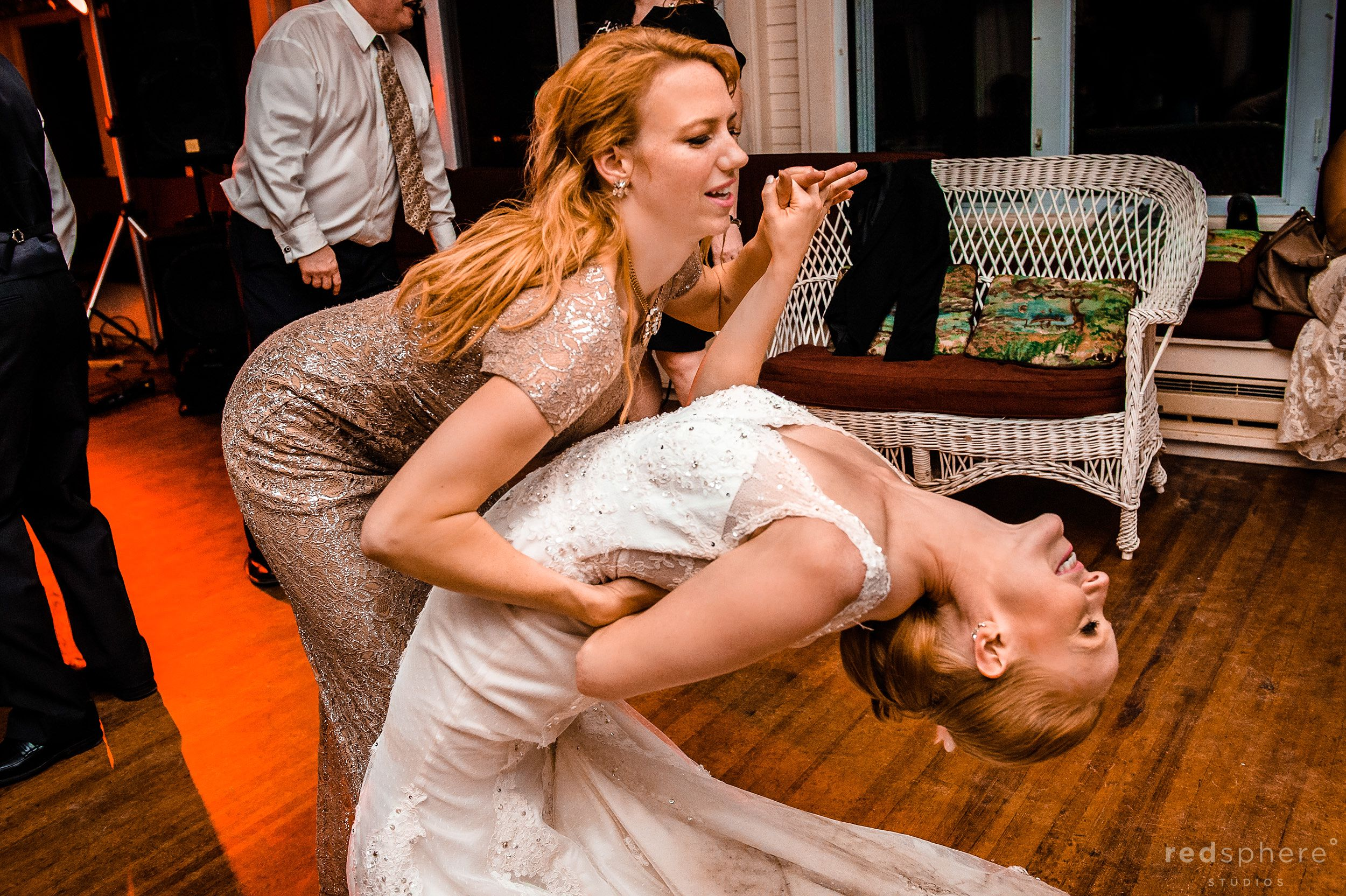 Bride and Maid of Honor Moment at Chapel Island Wedding After Party