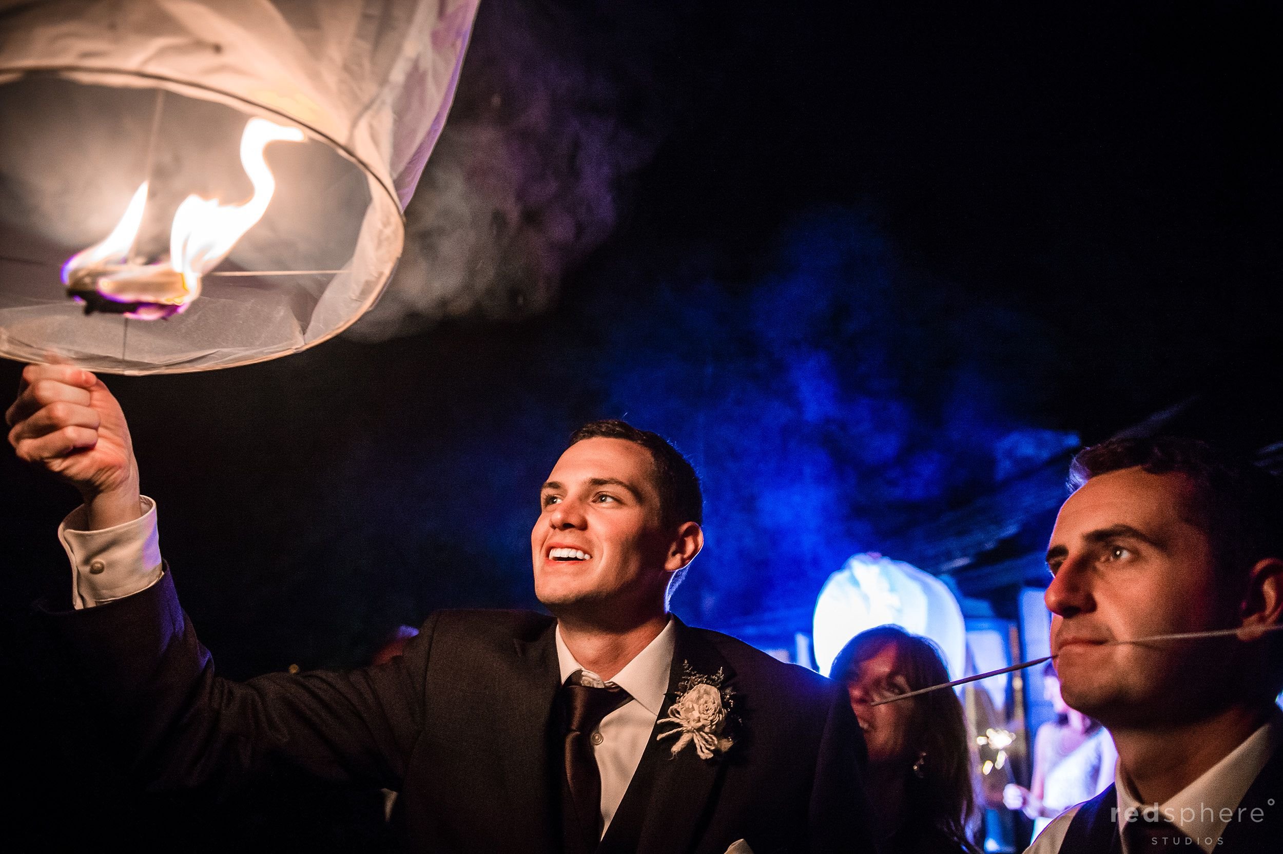 Groom Lighting Lanterns at Chapel Island Wedding Reception