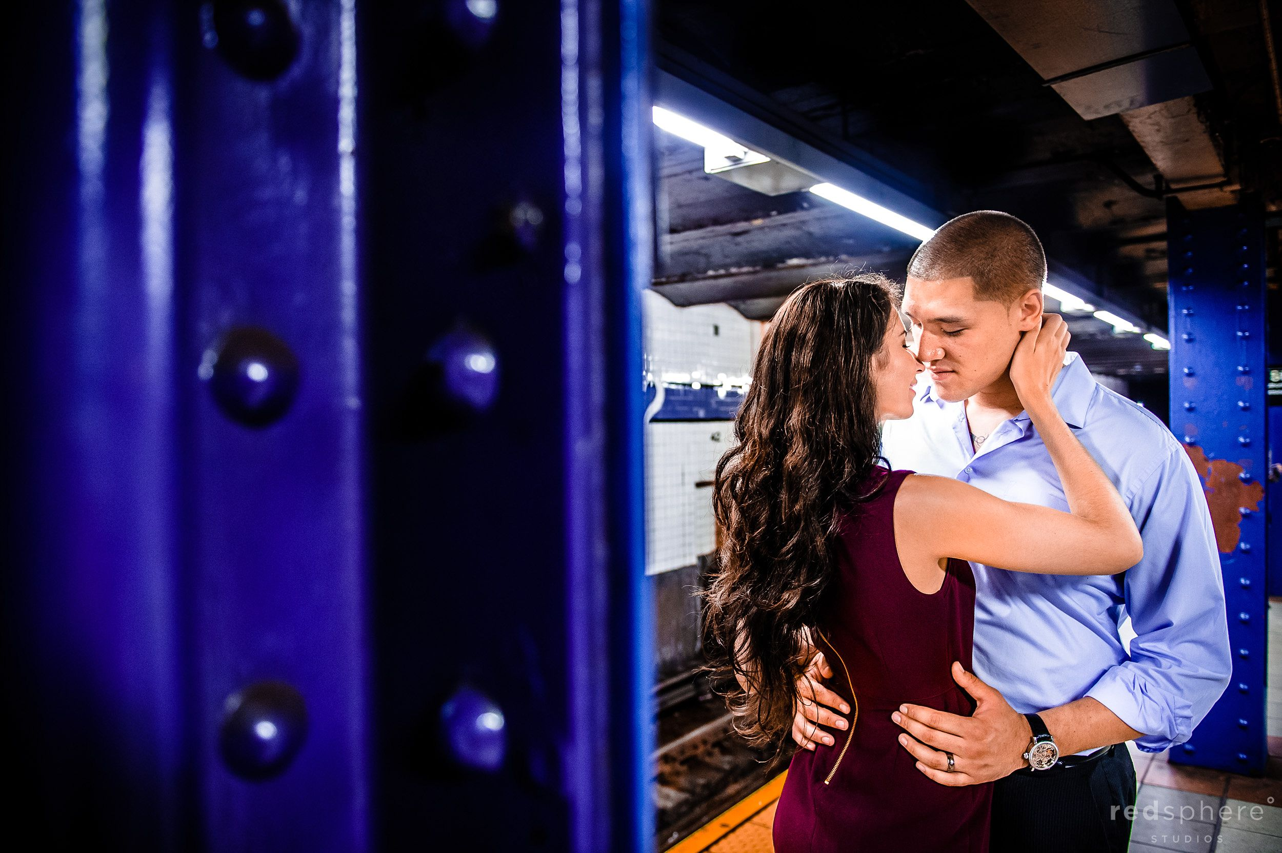 Couple Embrace in New York City's Subway Station Engagement