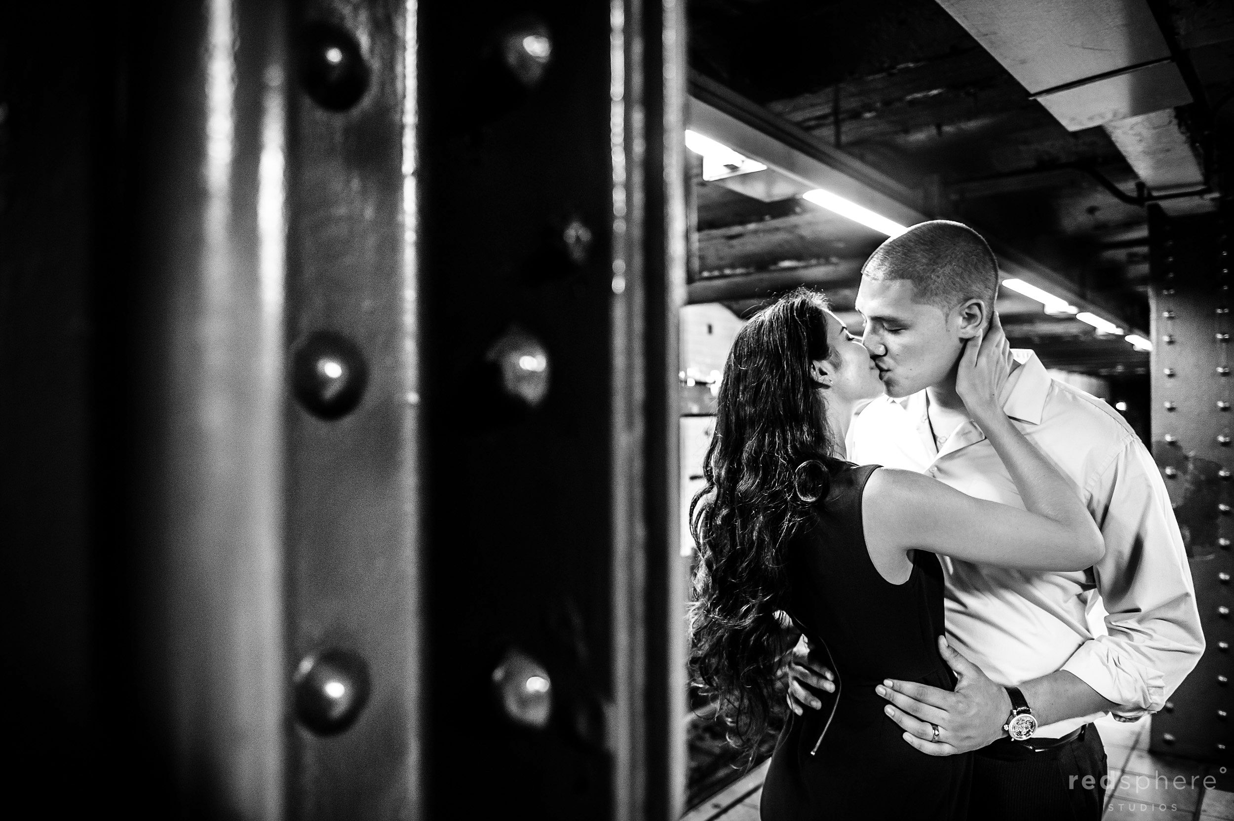 Couple Share a Kiss in New York City's Subway Station, Black and White Engagement