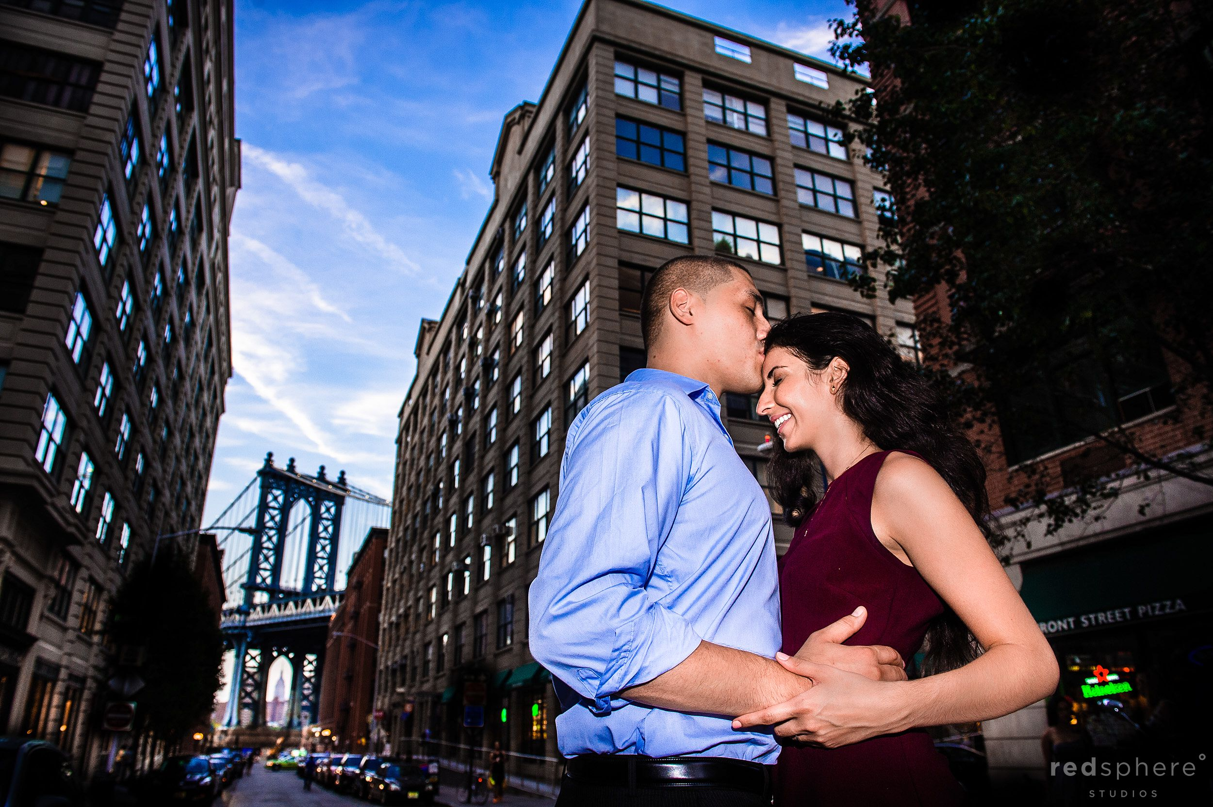 Couple Kiss in NYC Alley, Manhattan Bridge in the Background