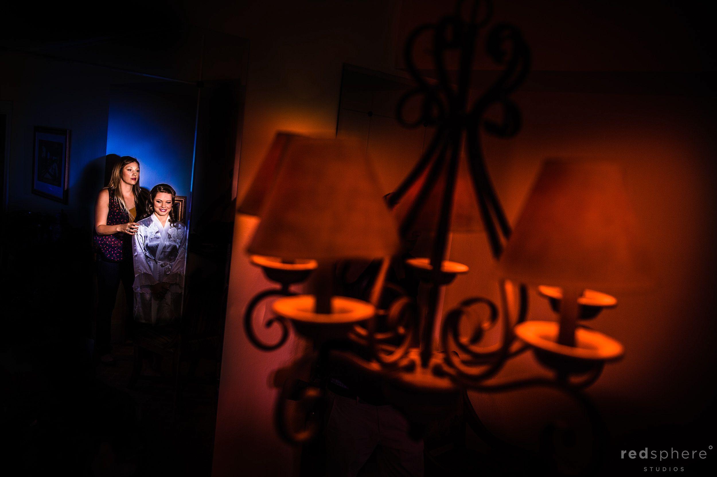 Bride Preparing in Dressing Room Behind Ceiling Lights
