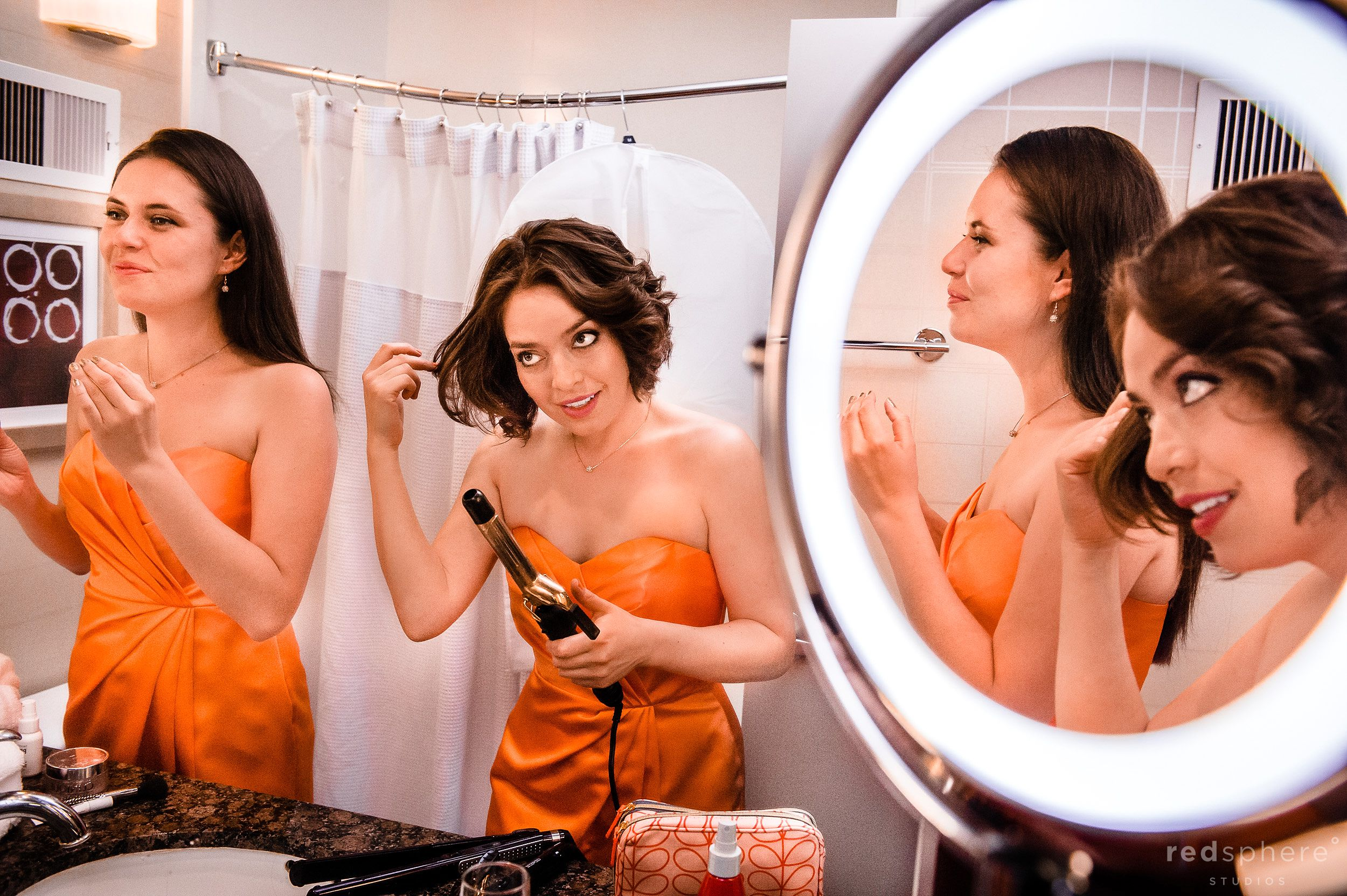 Bridesmaids Curling Hair and Putting on Makeup in the Bathroom