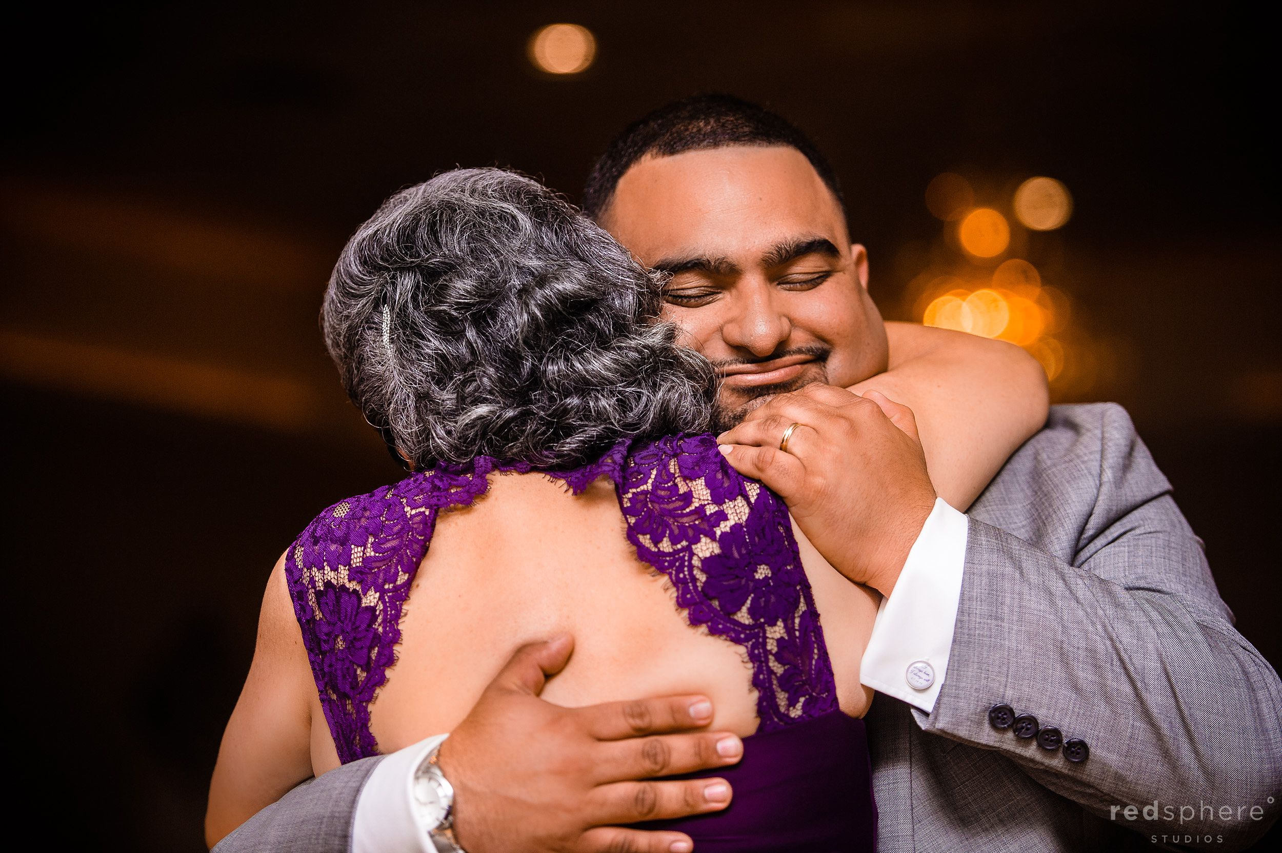 Groom Shares a hug With Family Member