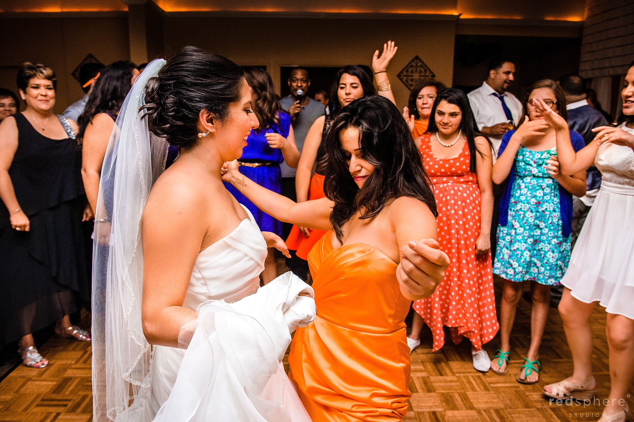 Bridesmaid and Bride Dancing on Dance Floor