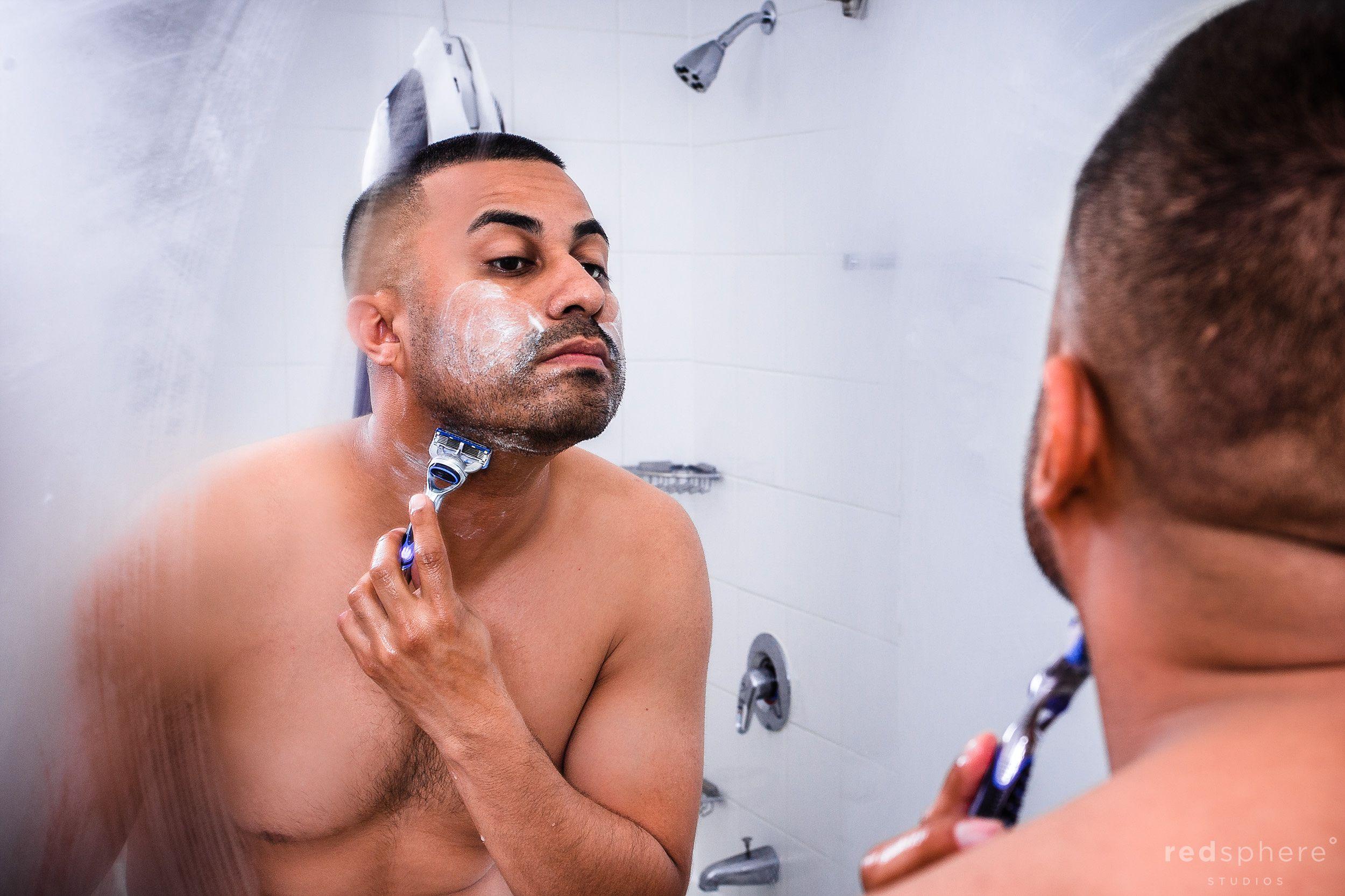 Groom Shaving Face as he Prepares for Wedding Day