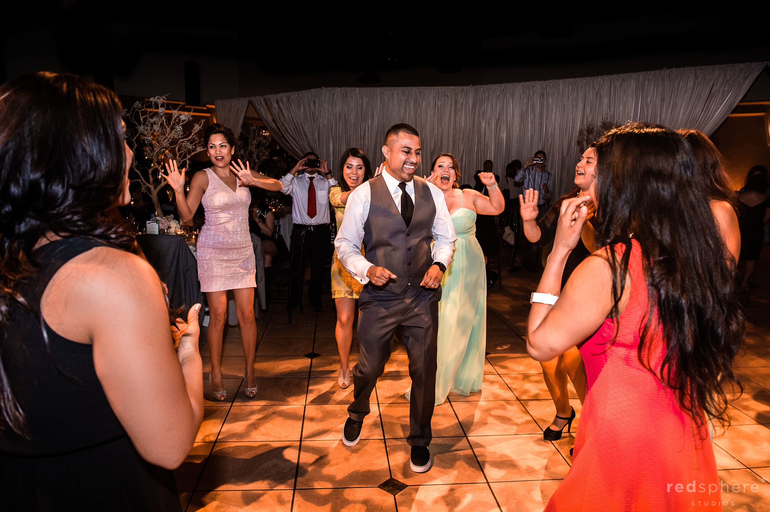 Groom Showing off Some Dance Moves on Dance Floor Palm Event Center